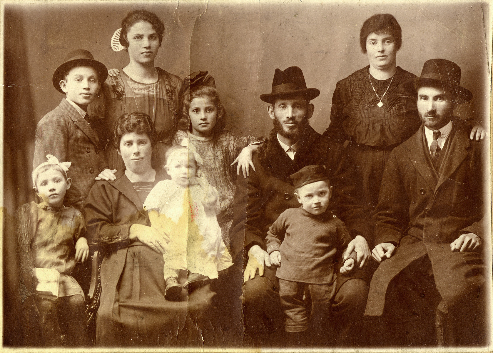 Studio portrait of the Freimowitz family.  Pictured from right to left are Zalman Dub, his wife Raizel Dub (sister of Bertha Freimowitz), Ferenz Freimowitz with Alex, Frida Freimowitz, Bertha Freimowitz holding her daughter Esther, Rachel Freimowitz, Morris Freimowitz and Goldie Freimowitz.