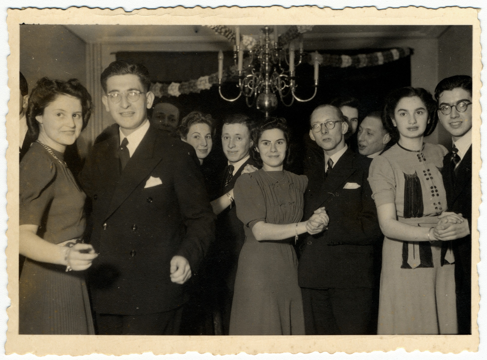 Young people dance at a party shortly after the German invasion of The Netherlands.  Ina Soep is with her boyfriend, Rudy Acohon on the far left.
