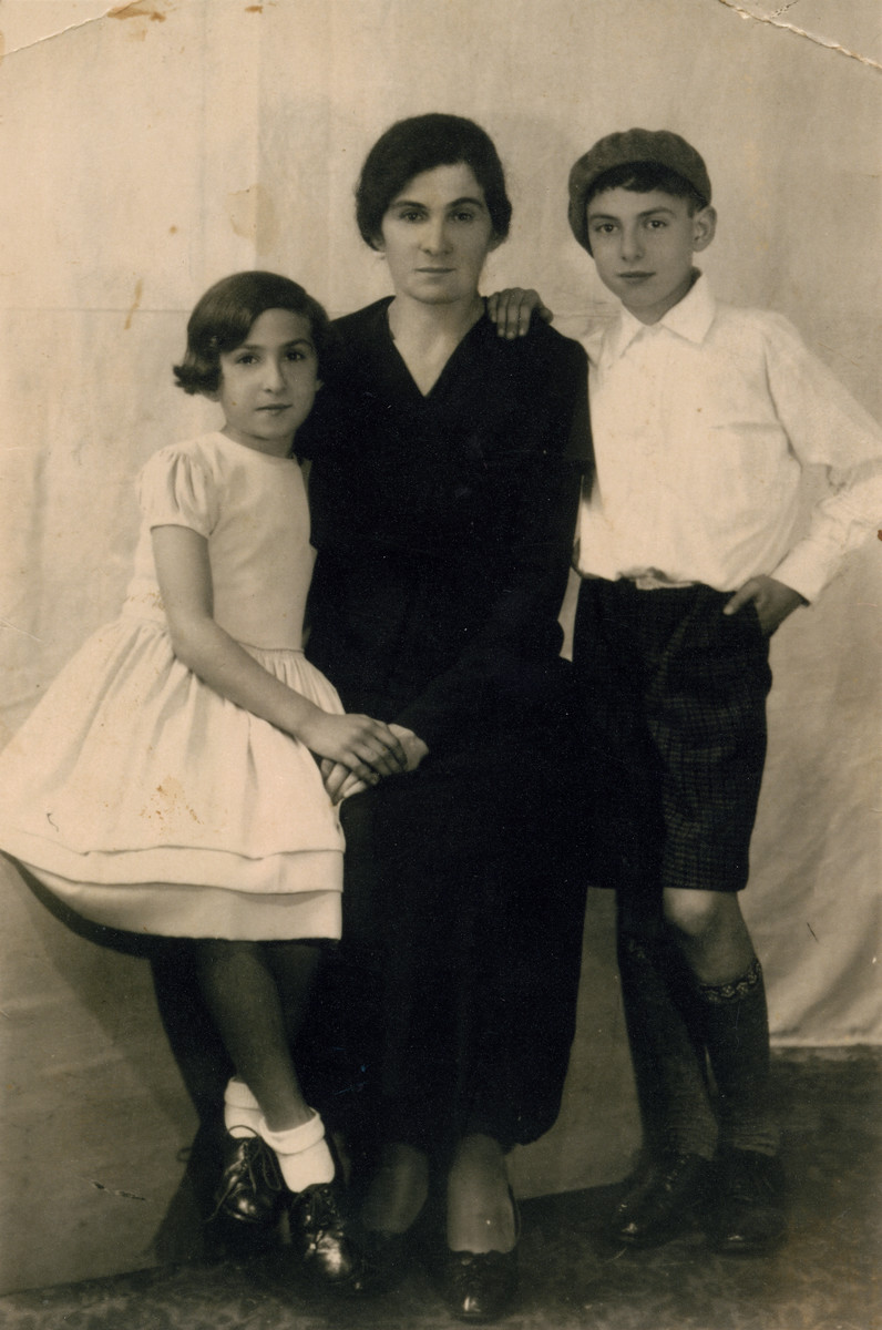 Studio portrait of Malka Leah Suesskind and her two children David and Tauba.