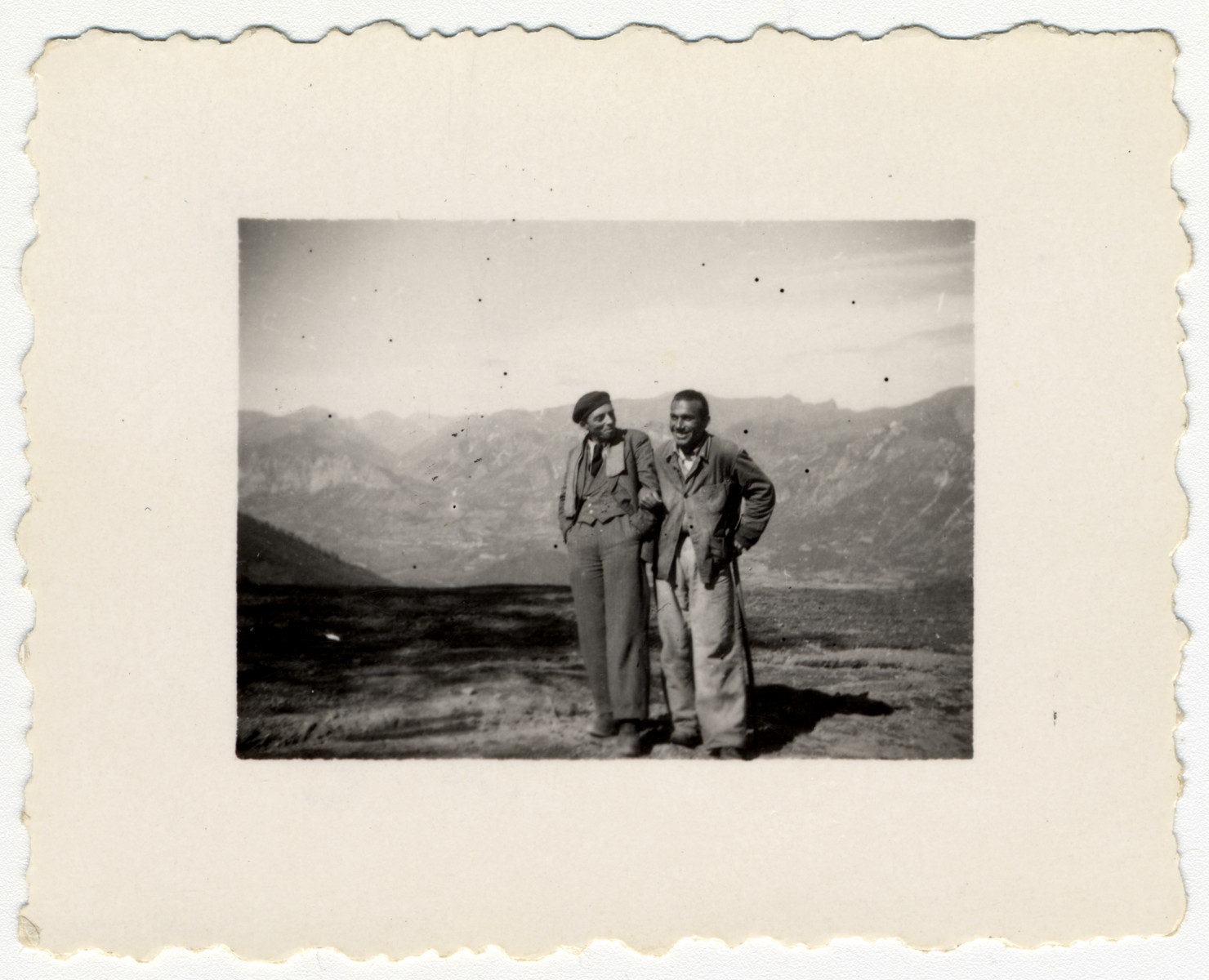 Austrian Jewish refugees, Franz Edelshein and Schwartz, pose with the Alps in the background in southern France.  Franz Edelshein was later arrested while trying to cross the border into Switzerland.