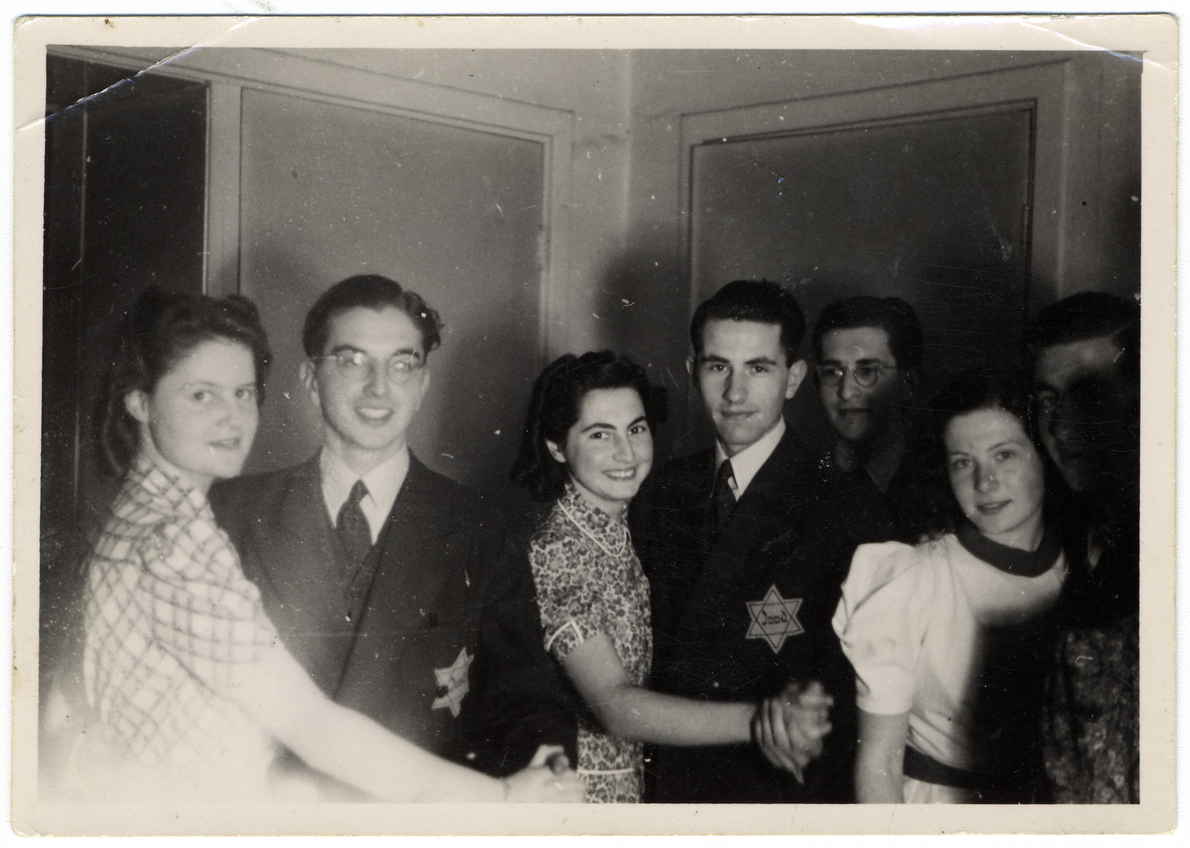 Jewish teenagers wearing Jewish stars dance at a party hosted by Rudy Acohen shortly before he was arrested in a reprisal action and sent to Auschwitz where he perished.   Ina Soep (left) is dancing with Harts Nijstad. Her boyfriend Rudi Acohen is dancing with Sera van Esso (second couple to the left).