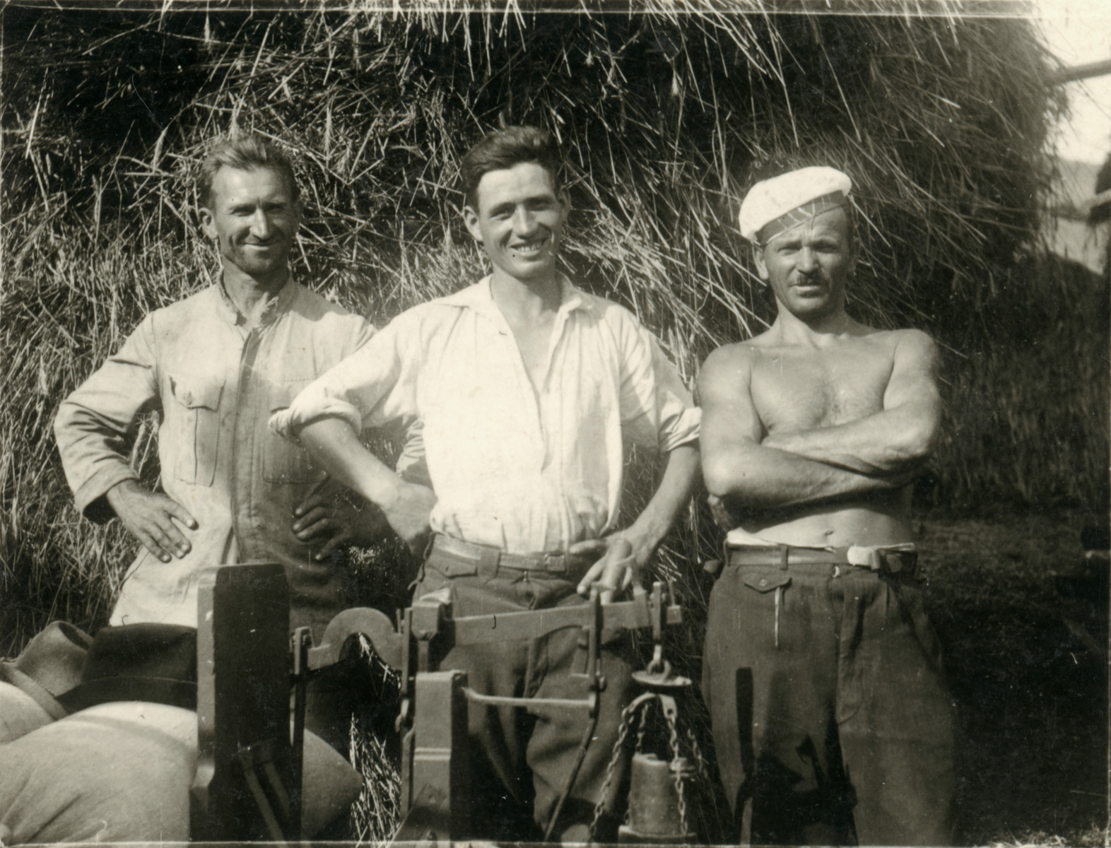Avraham Koviliak (right) and two other men work on a farm.