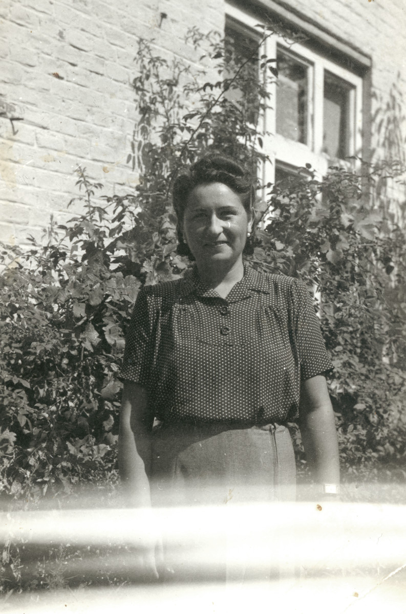 Eva (Hava) Weiss stands outside [probably in front of her house] in 1941, about three years prior to her deportation to Auschwitz.