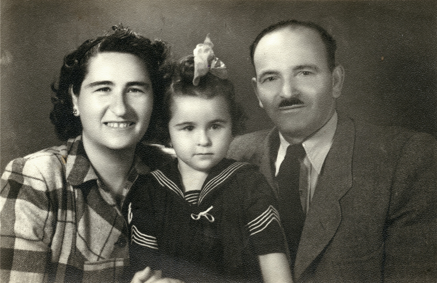 Studio portrait of Eva (Hava), Sara and Avraham Bernat Koviliak  in Israel, ca. 1950