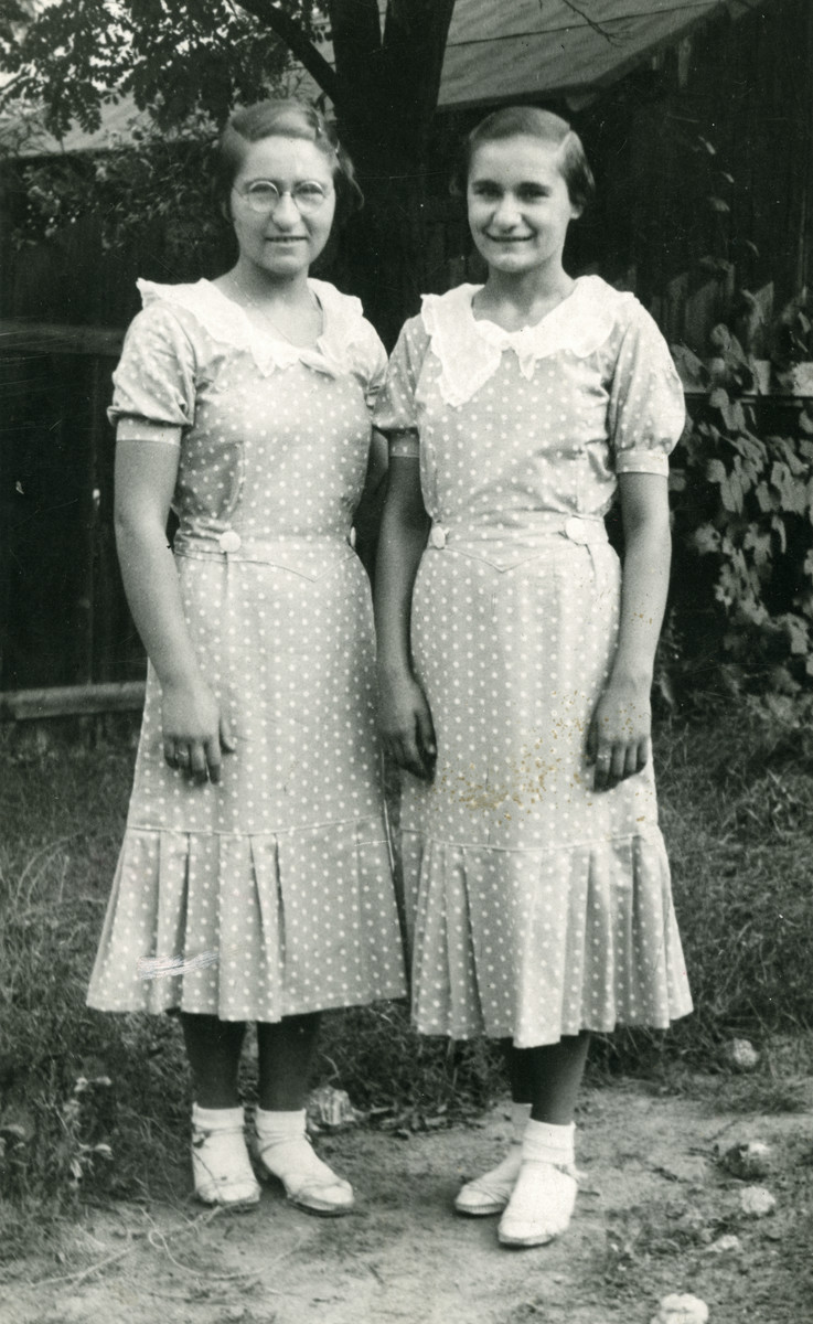 Eva (Hava) Weiss (left) and her cousin, Yolanda Schwaitz (right) pose in matching dresses. (Eva's mother, Sara Berta Rotman made the dresses.)