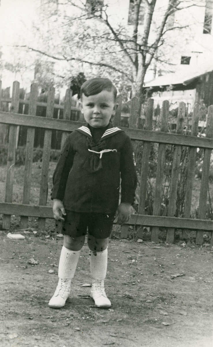 Thomas (Tomika) Koviliak stands in a yard in 1932. He perished at Auschwitz.