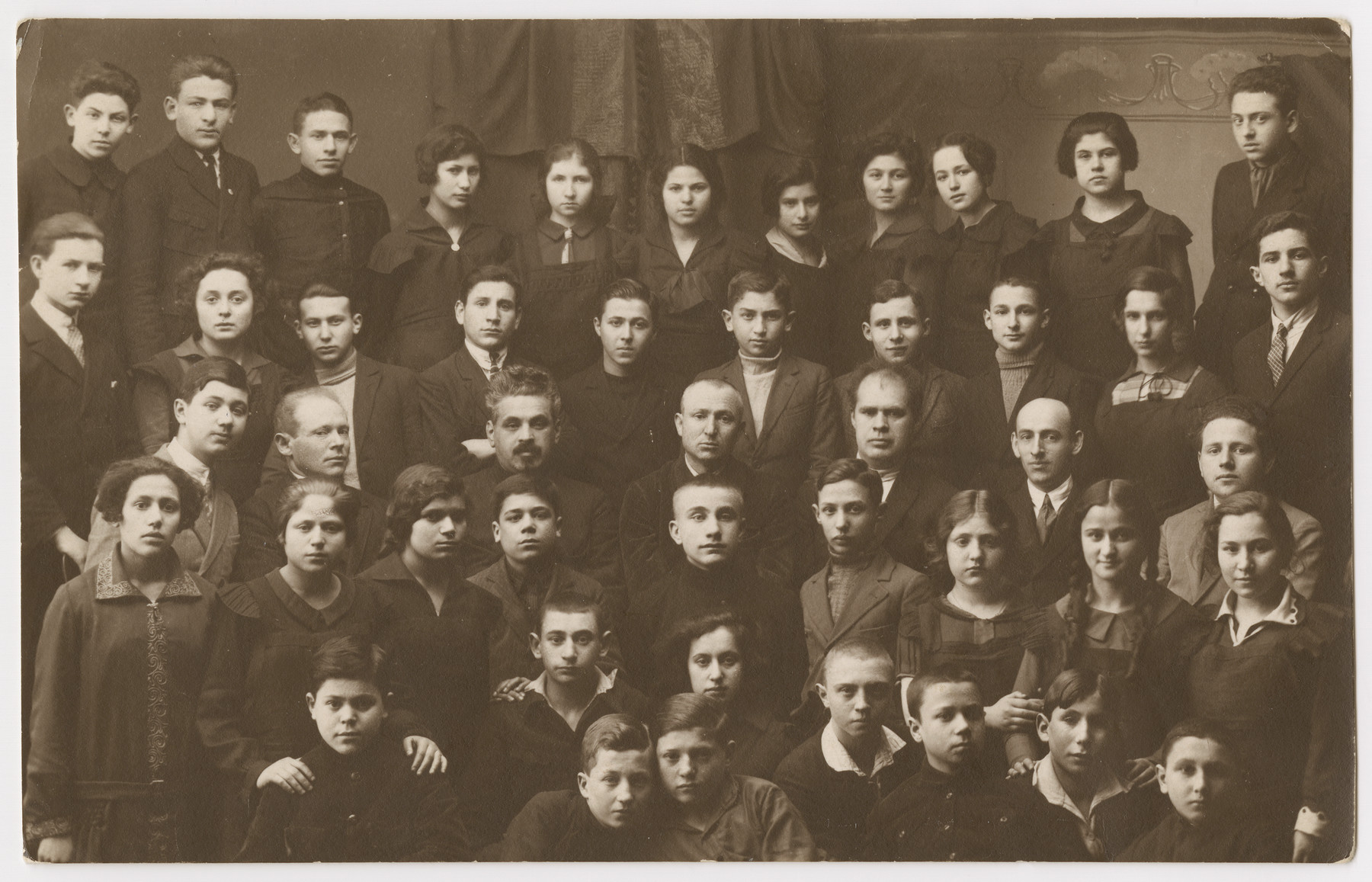 """Group portrait of Jewish students in the Vilna gymnasium.  Golda (Olinka) Mirski is pictured on the top row, fifth from the left.  The original Yiddish inscription reads: """"To my dear beloved brother-in-law Abrasha."""""""