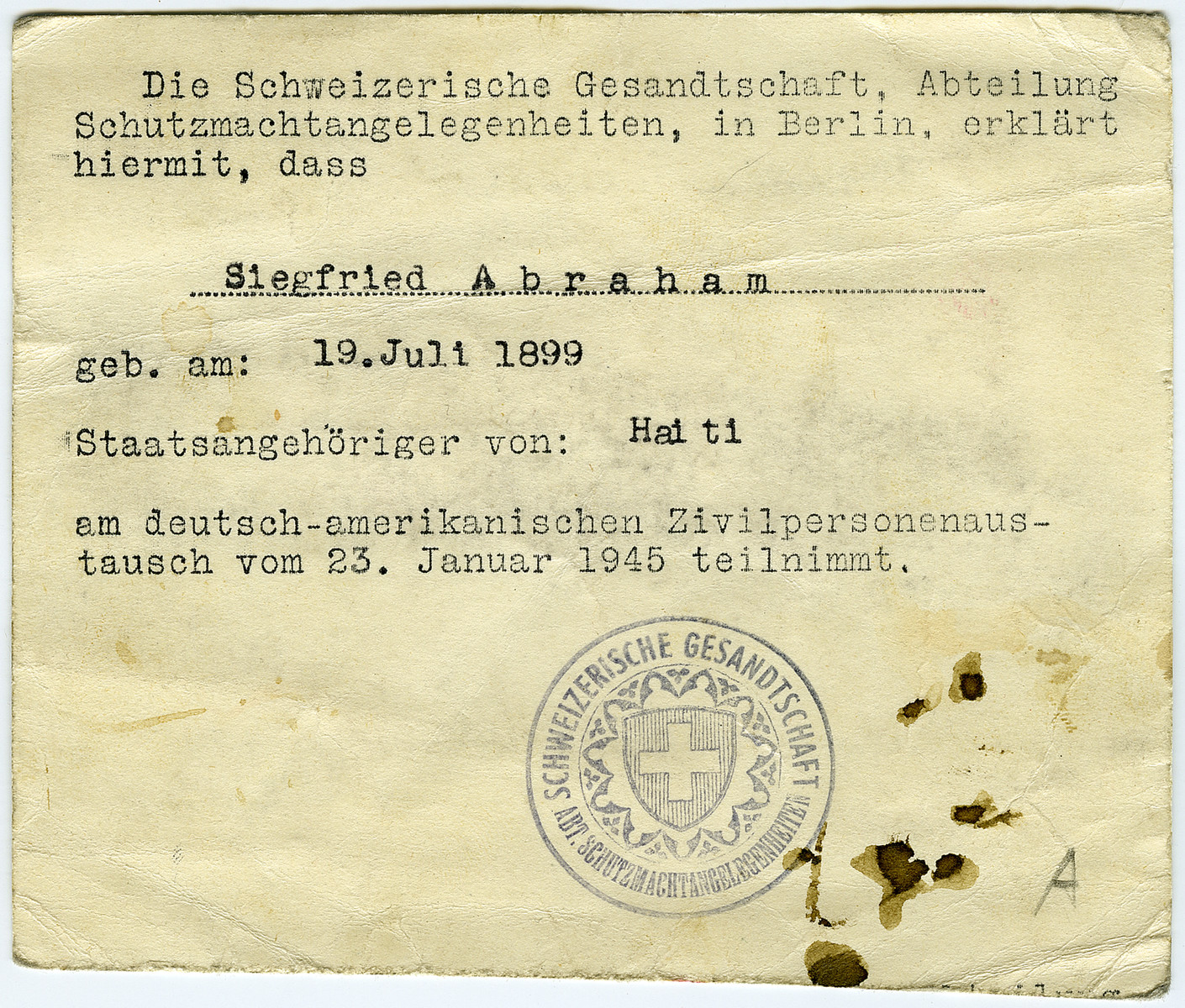 Identification paper issued to Siegfried Abraham in Switzerland following his release from Bergen-Belsen in a prisoner release stating that he had Haitian citizenship.