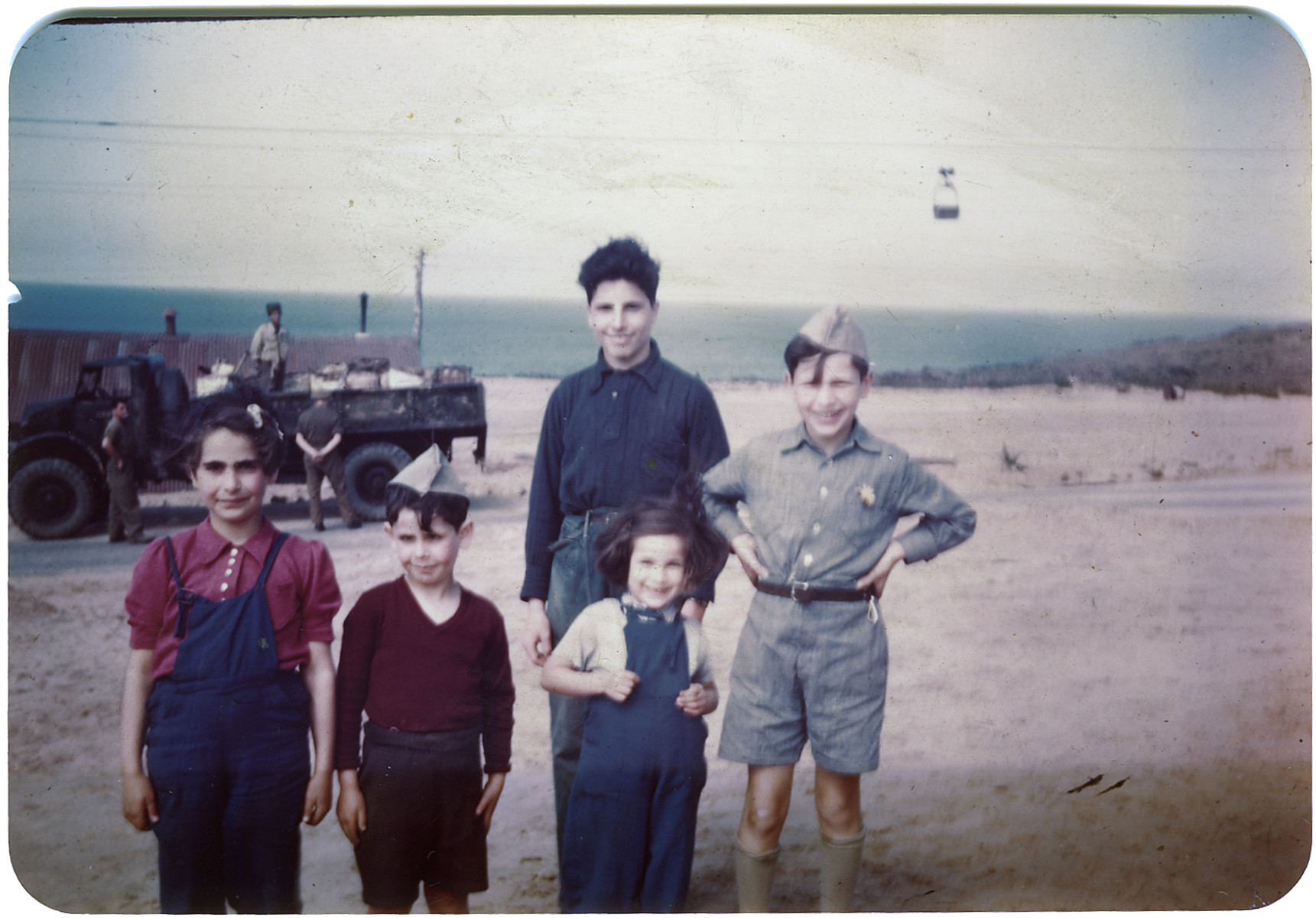 Group portrait of Jewish children in the Jeanne d'Arc camp in Phillippeville who were sent their following their release from Bergen-Belsen in a prisoner exchange.  Hans Abraham is on the far right, and Ruth Abraham is in the front right.