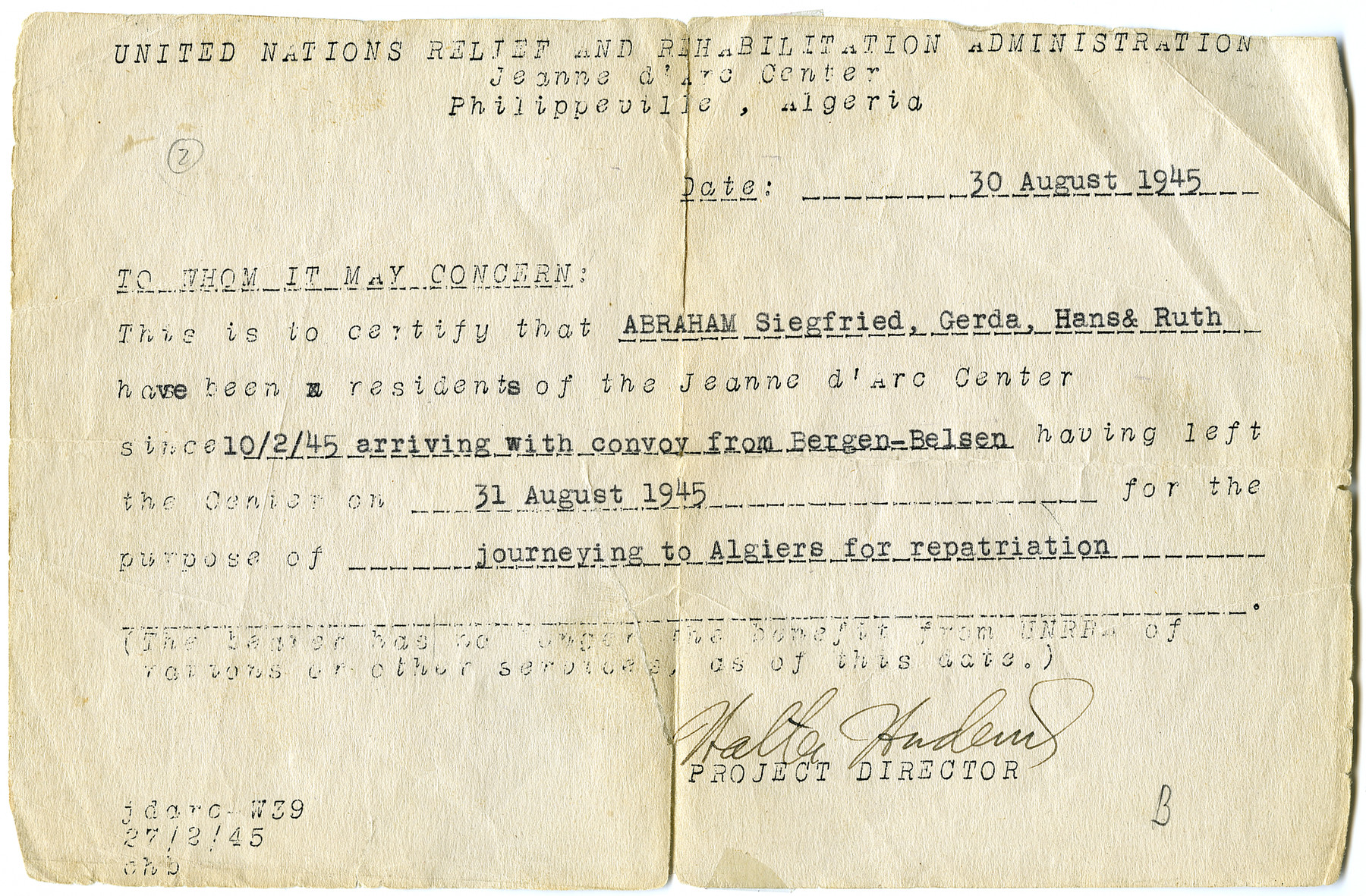 UNRRA card issued to the Abraham family stating they had arrived in the Philippeville camp following their release from Bergen-Belsen and were now journying to Algiers for repatriation.