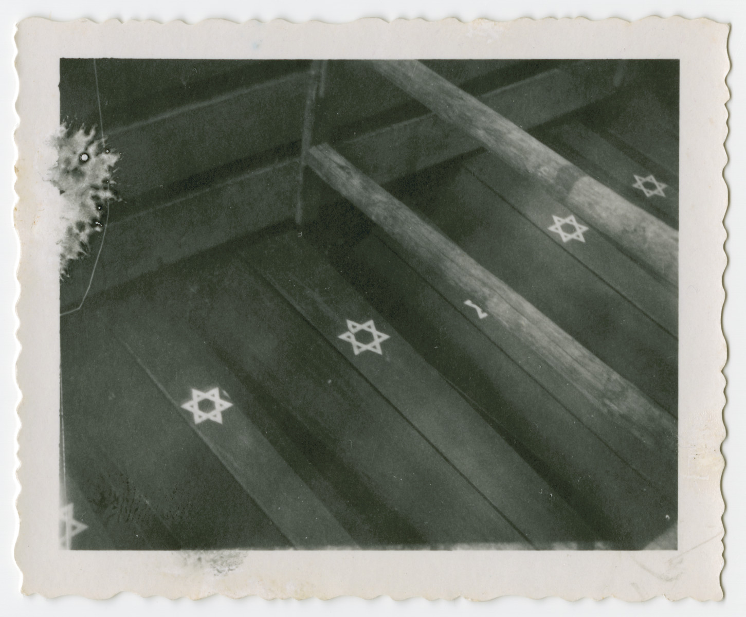 View of coffins marked with a Star of David used in the reburial of Jewish victims of the Holocaust.