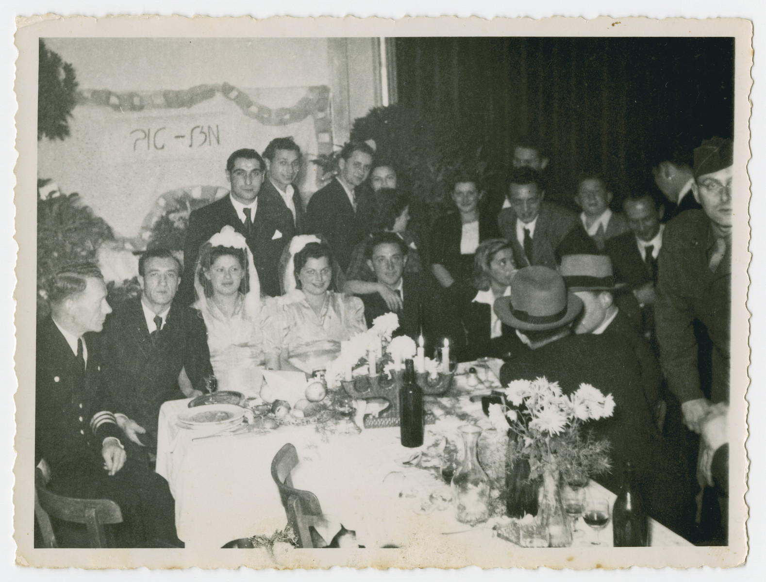 Jewish displaced persons celebrate a double wedding [probably in the Heidenheim displaced persons camp.]