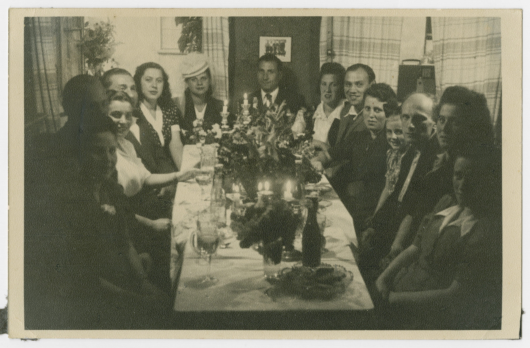 Jewish displaced persons sit down to a festive meal, possibly in Weiden.