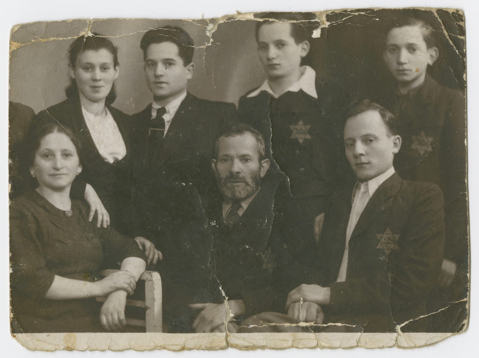 Portrait of the Bronner famiy wearing Jewish stars.  Among those pictured is Schulim Bronner.