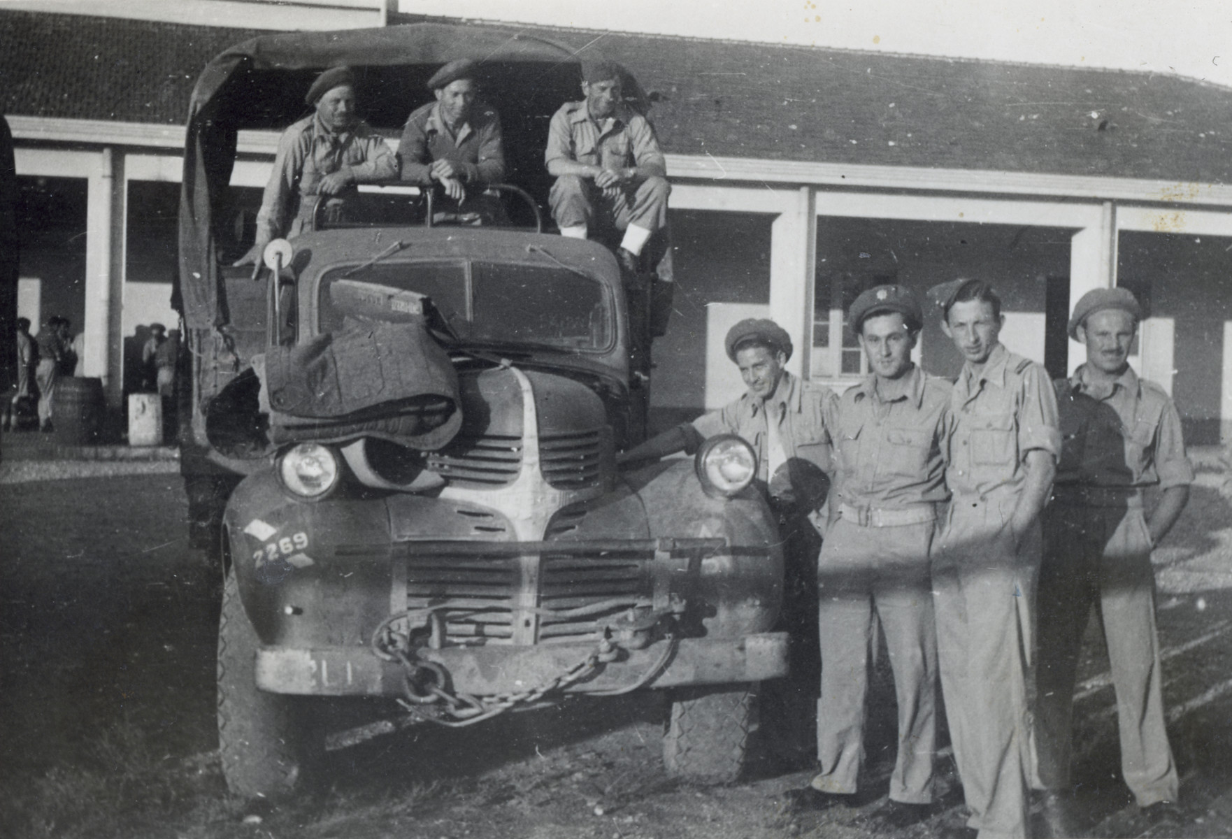 Group portrait of soldiers in the Jewish Brigade posing next to a truck in Italy.  Among those in the unit is Yaakov (Bandi) Sigmund (who took the snapshot).