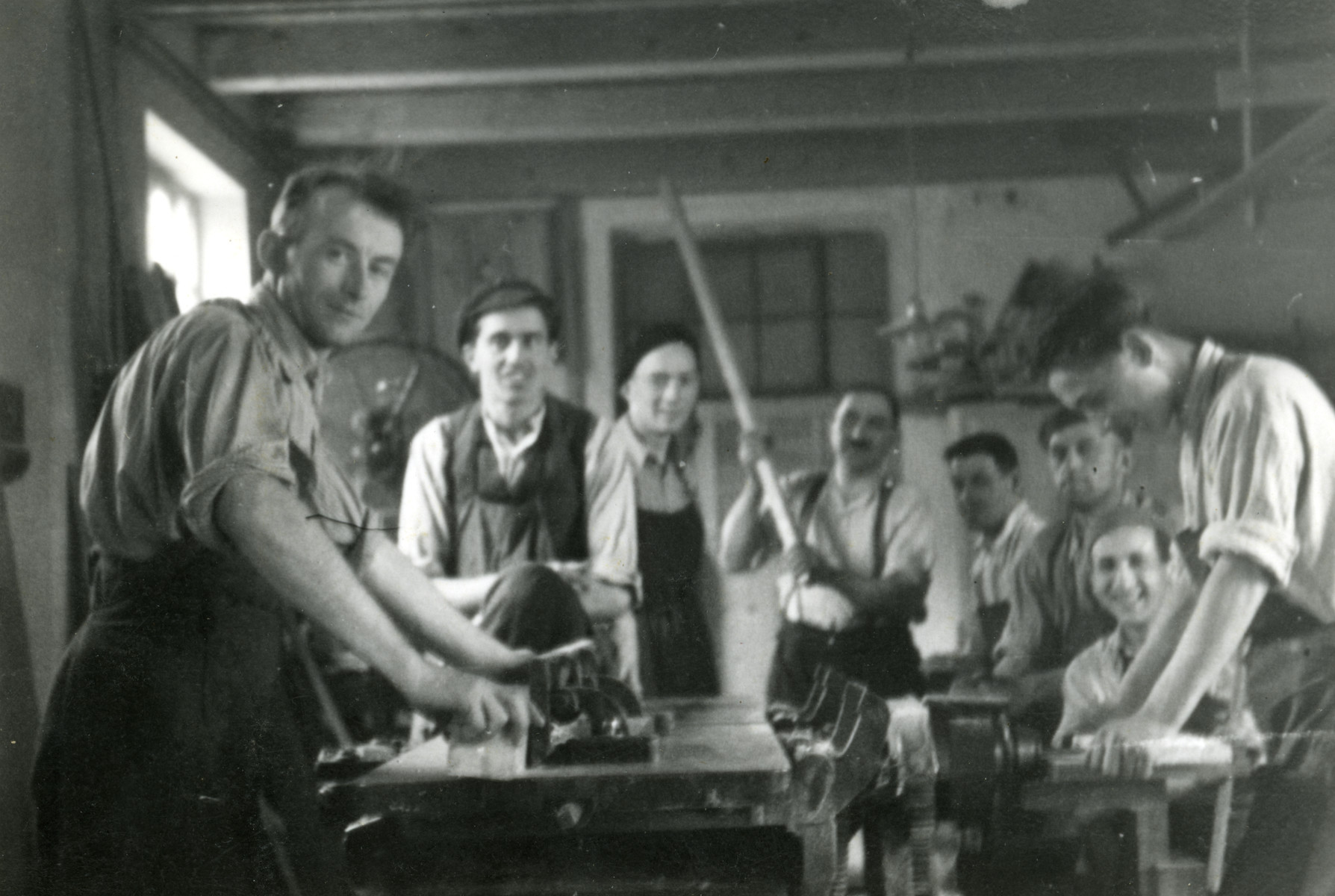 Jewish internees work in the wood workshop in the Novaky concentration camp.