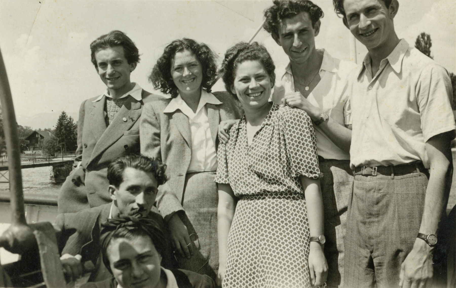 Group portrait of Jewish youth in Switzerland, who survived the war with the Kasztner transport, on a trip to Geneva.  From left to right: Judith Nobel (bottom), Leo and Dina Jung (fromYugoslovakia),  Suzanne Sigmund (third from right), her future husband Milan Uri Mayer, Emanuel Diamant, Baruch Robinsohn, and unknown.
