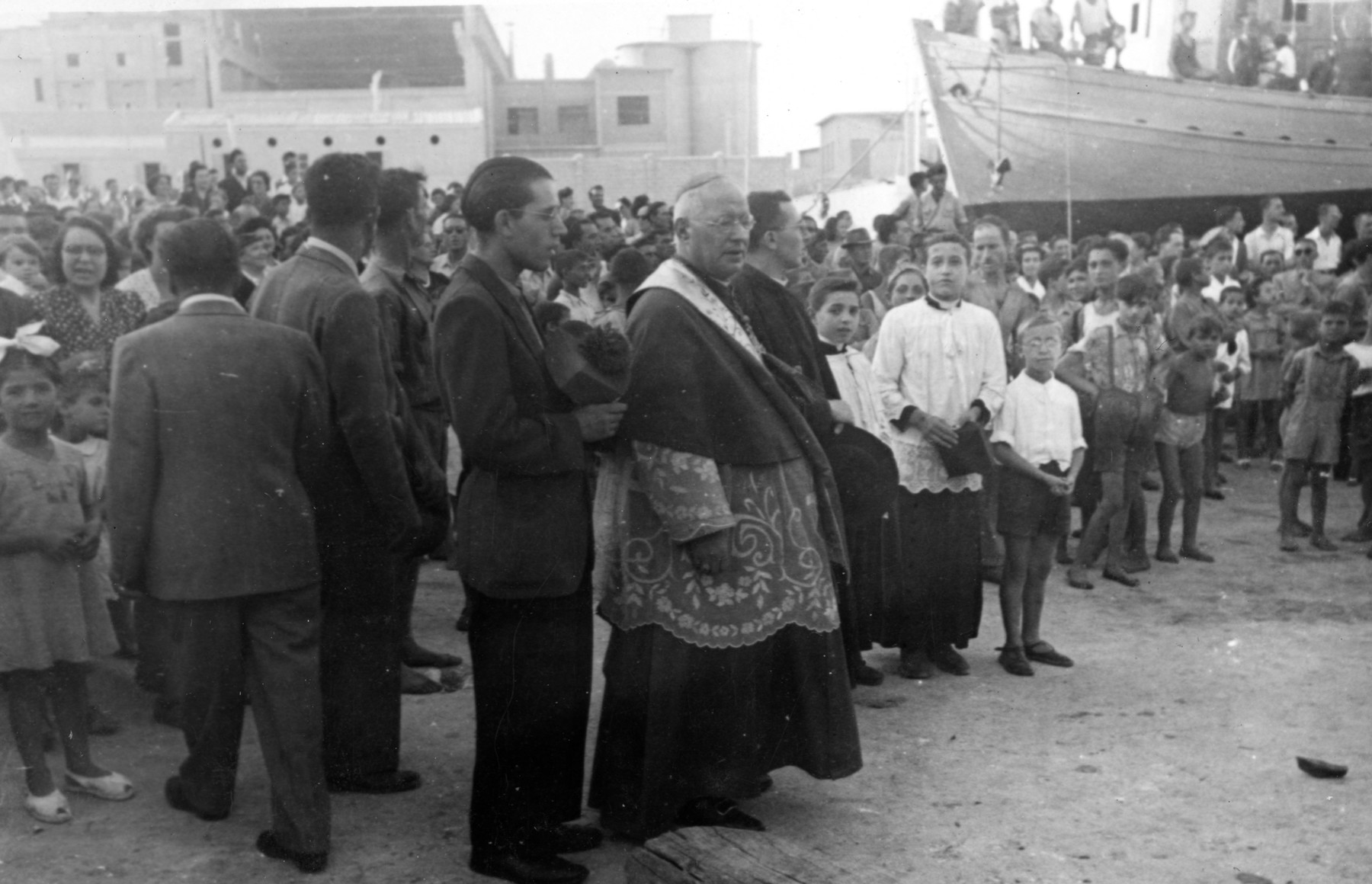 Italian priests bless the Dalin prior to its sailing from Monopoli to Palestine with 37 immigrants on board.