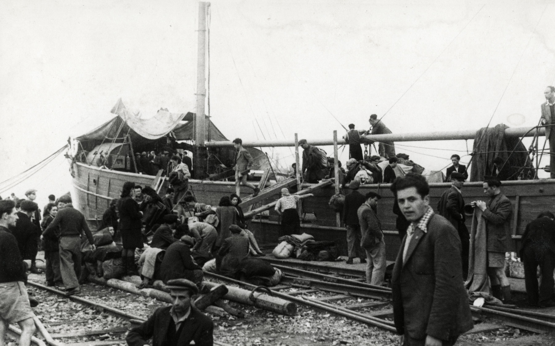 Jewish displaced persons gather at La Spezia harbor where they are conducting a hunger strike to garner support for their desire to immigrate to Palestine.