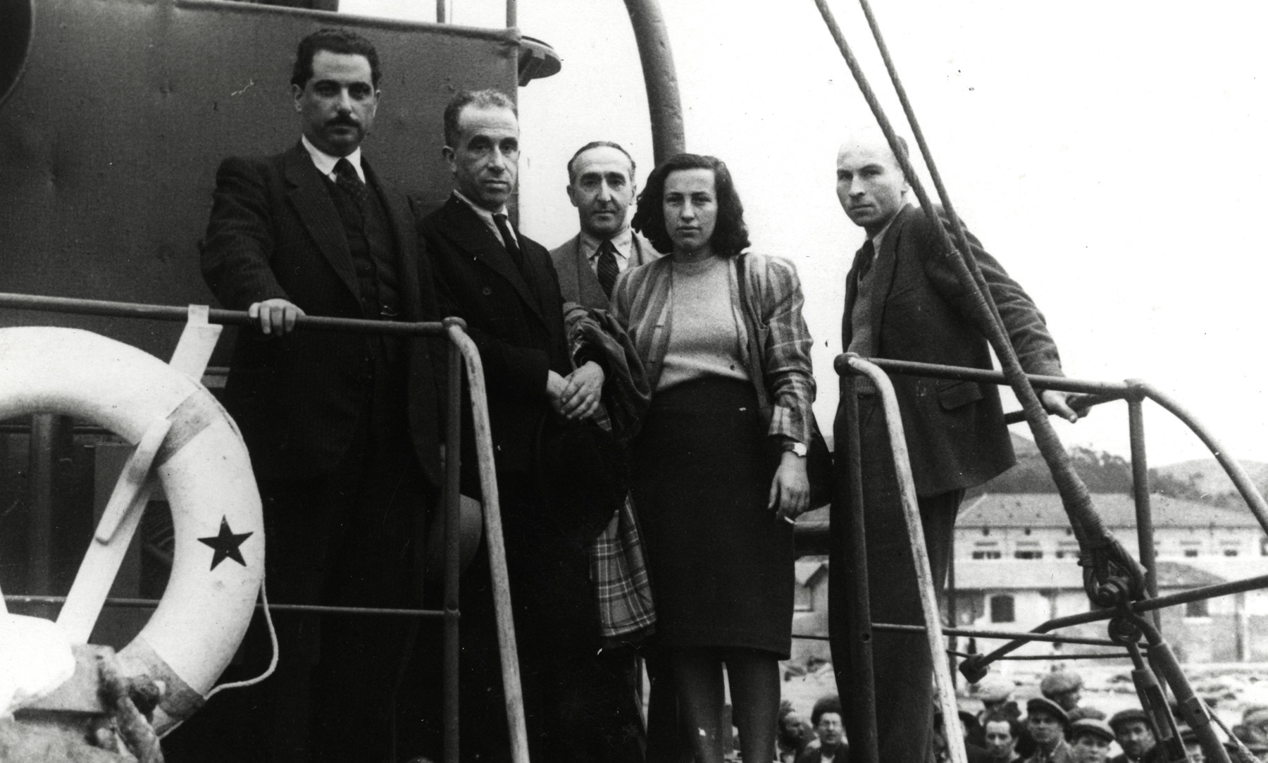 Jewish displaced persons or crew members pose on board the Eliyahu Golomb in La Spezia harbor.