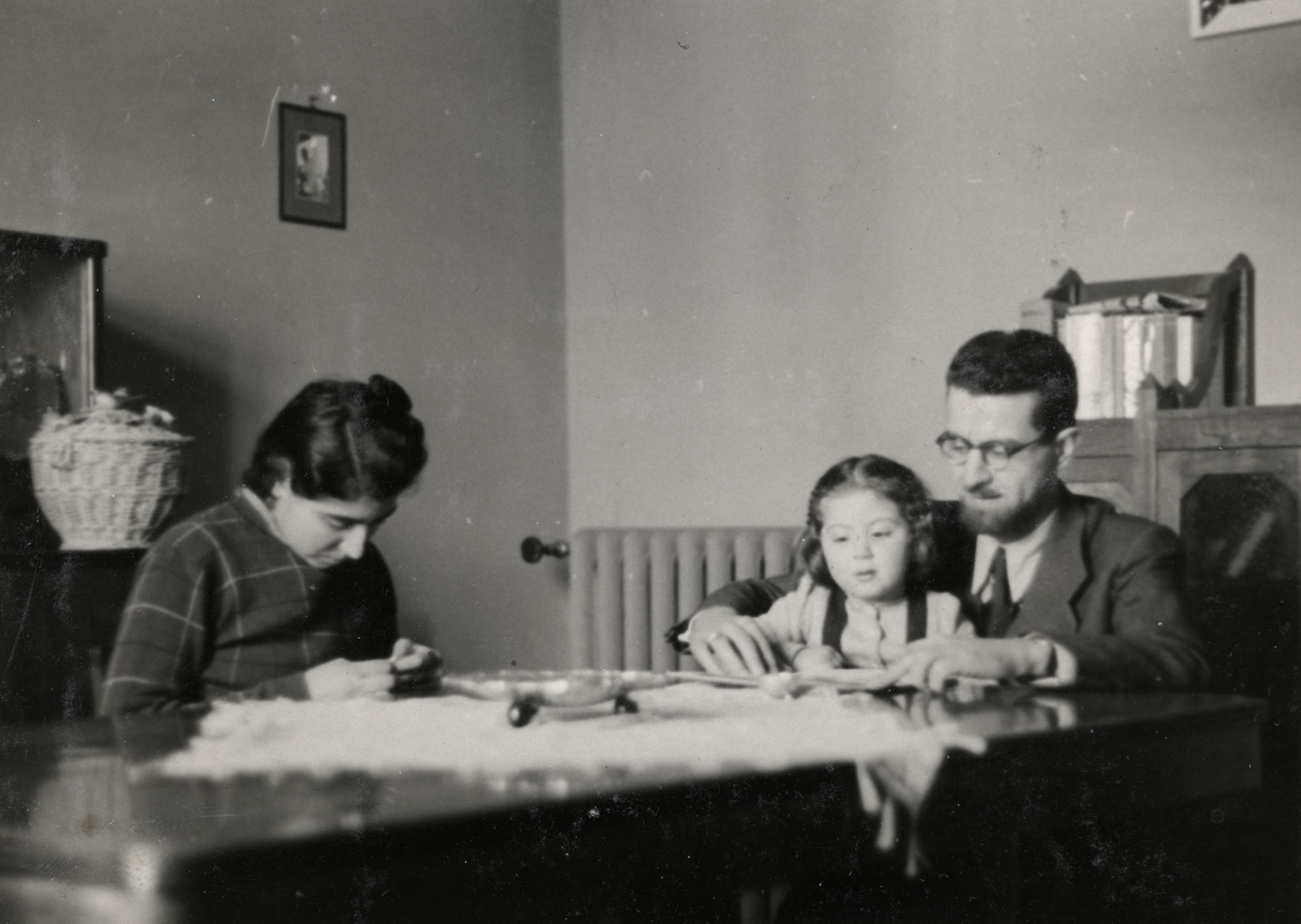Shaul, Ada and Leah Nissim sit in the dining room of their home in Padua.
