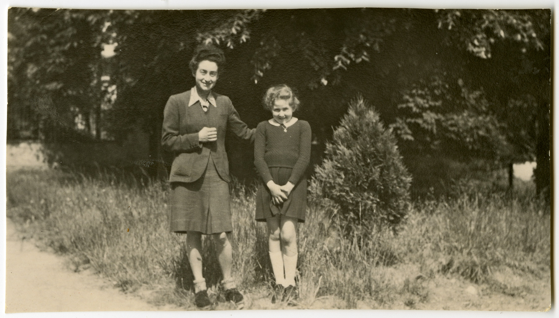 "Myriam Mayer poses with her youngest aunt Simone Kohn while in hiding tin the Convent in Gayette towards the end of the war.  Simone Kohn (later Dauzeral) was born in 1925.  She was 19 and was working in the convent as a ""surveillante"" (teacher's aide)."