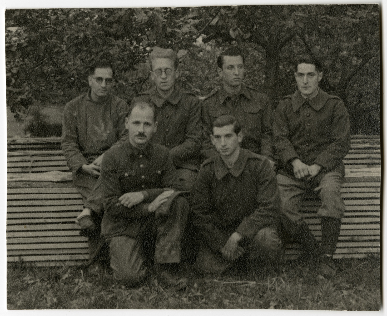 Group portrait of Belgian prisoners of war in Stalag XC in Nienburg-Weser.  Among those pictured are two Jewish POWS,  Jean-Pierre Mayer-Astruc (front left) and his friend Alexis Goldschmidt.