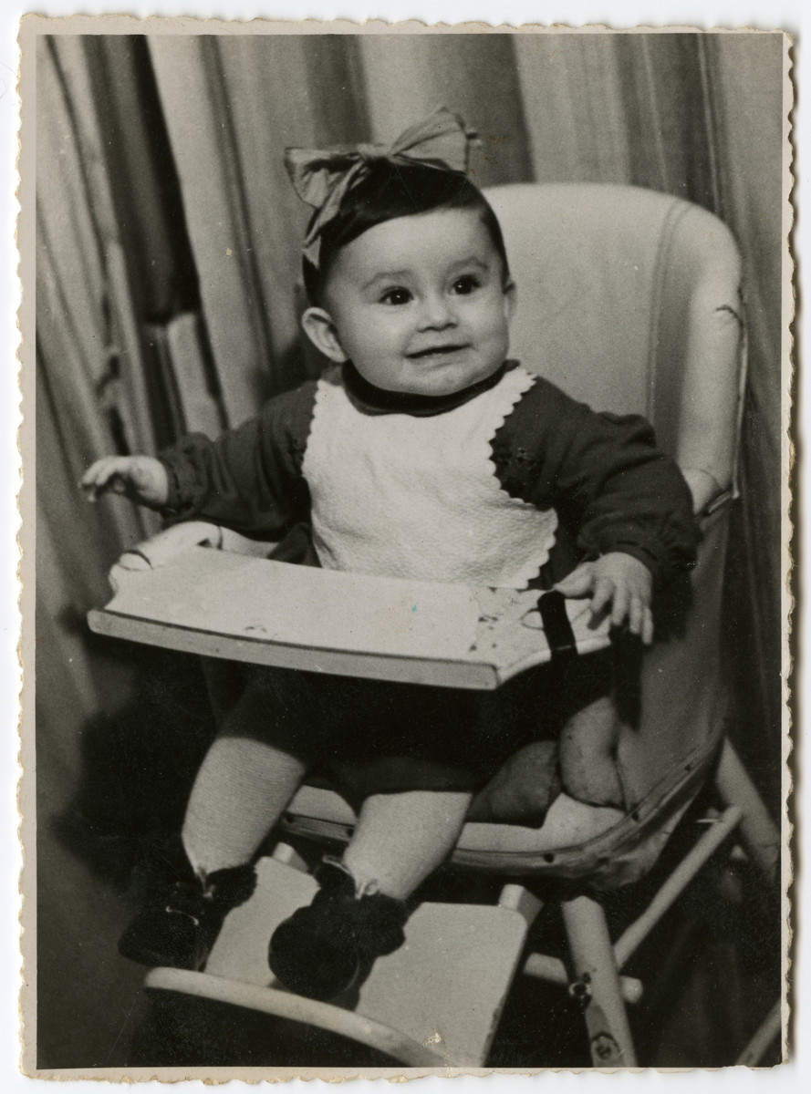 Sara Radzelli sits in her high chair in the Schlachtensee displaced persons' camp.