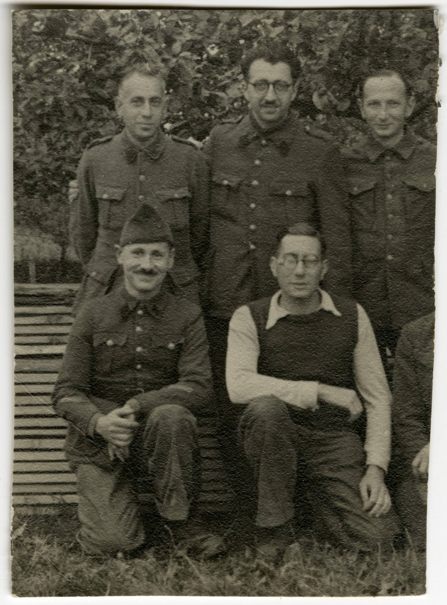 Group portrait of Belgian prisoners of war in Stalag XC in Nienburg-Weser.  Among those pictured are two Jewish POWS,  Jean-Pierre Mayer-Astruc (front left) and his friend Alexis Goldschmidt.  Also pictured is Leopold Guttman (top row, standing center) and Henry Kahn (top, right).