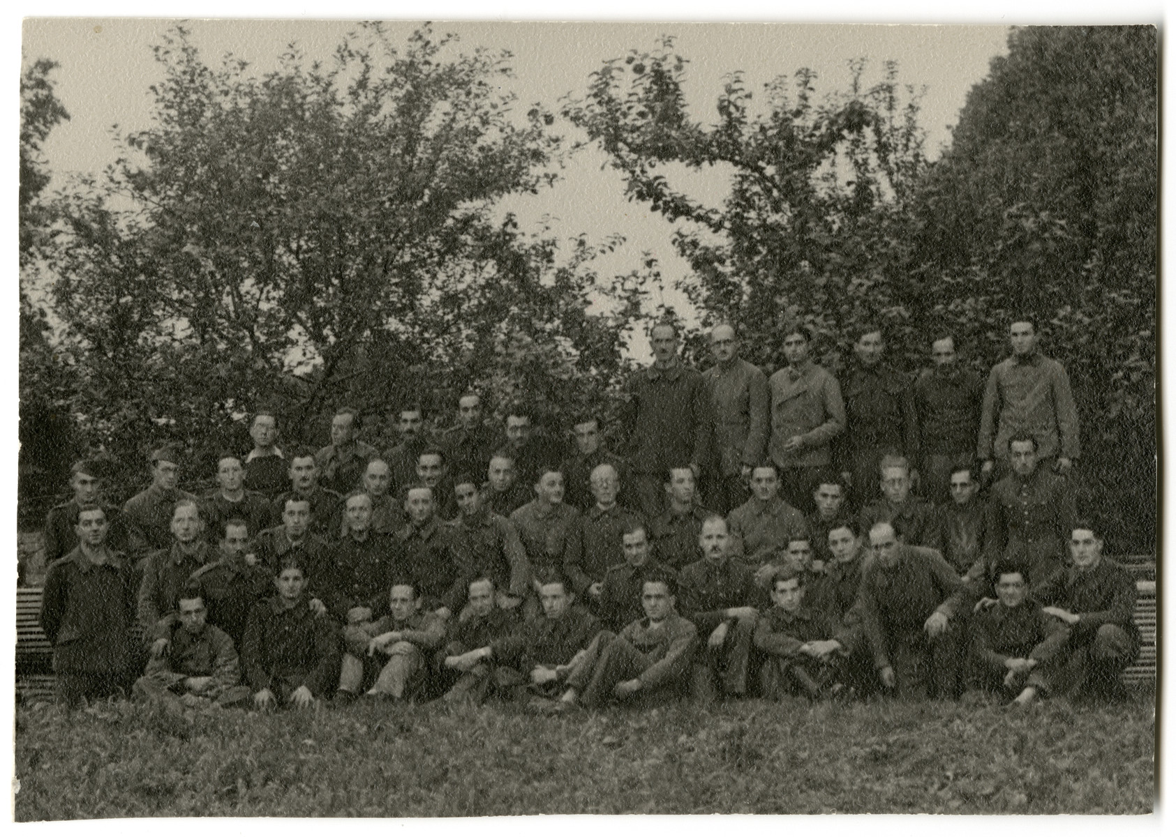 Group portrait of Belgian prisoners of war in Stalag XC in Nienburg-Weser.  Among those pictured are two Jewish POWS,  Jean-Pierre Mayer-Astruc and his friend Alexis Goldschmidt. Also pictured is Leopold Guttmann, top row, fifth from the left.