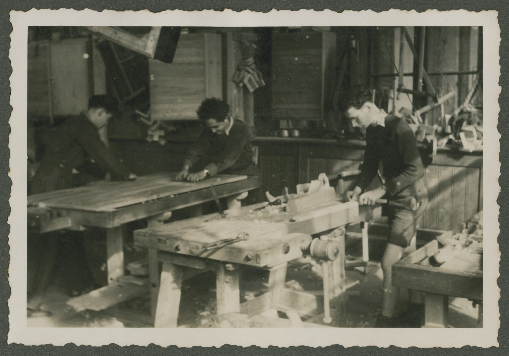 Three teenage boys work in a carpentry workshop in a Zionist children's home in Switzerland.