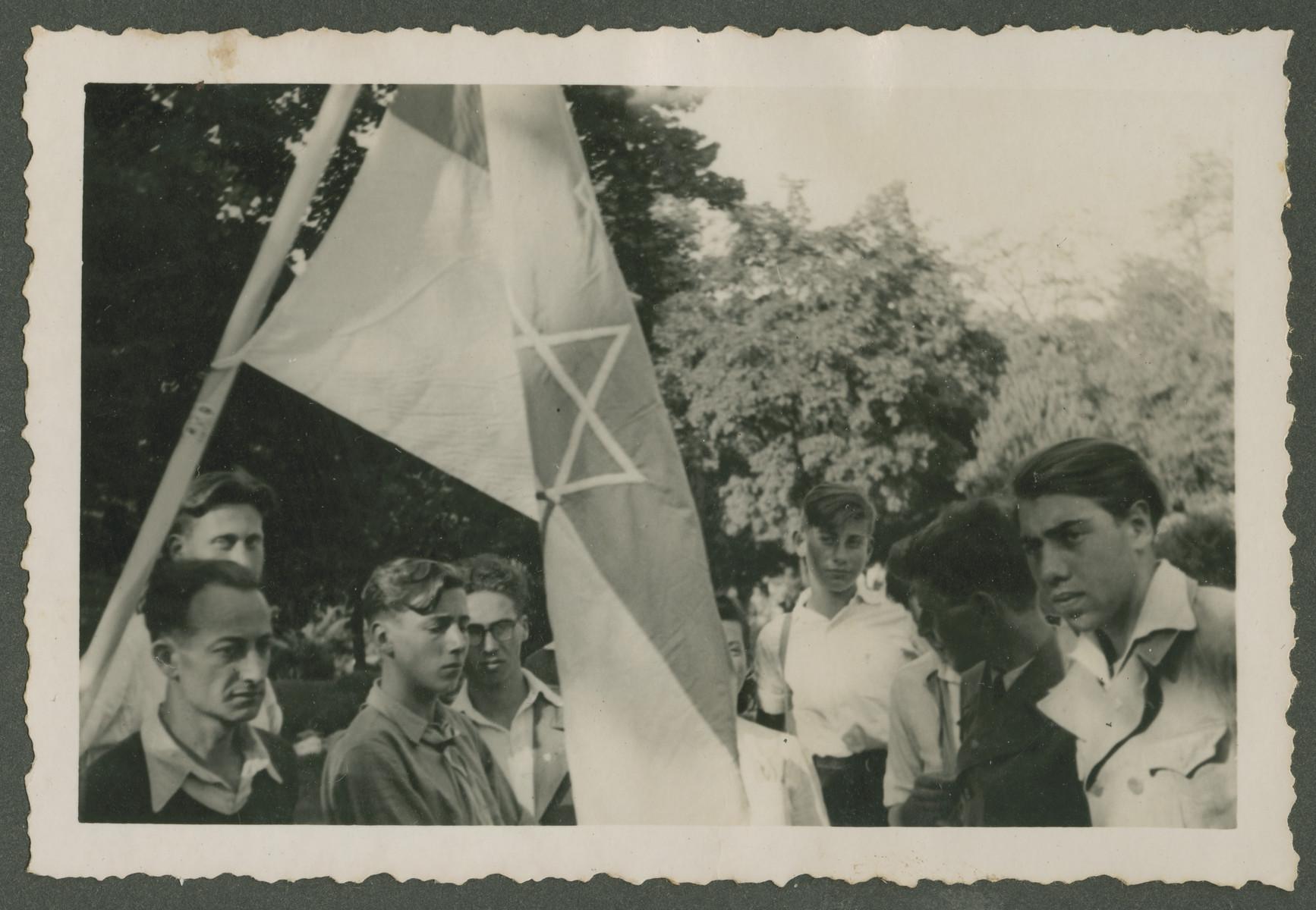 Teenage boys gather around a Zionist flag in a children's home in Switzerland.