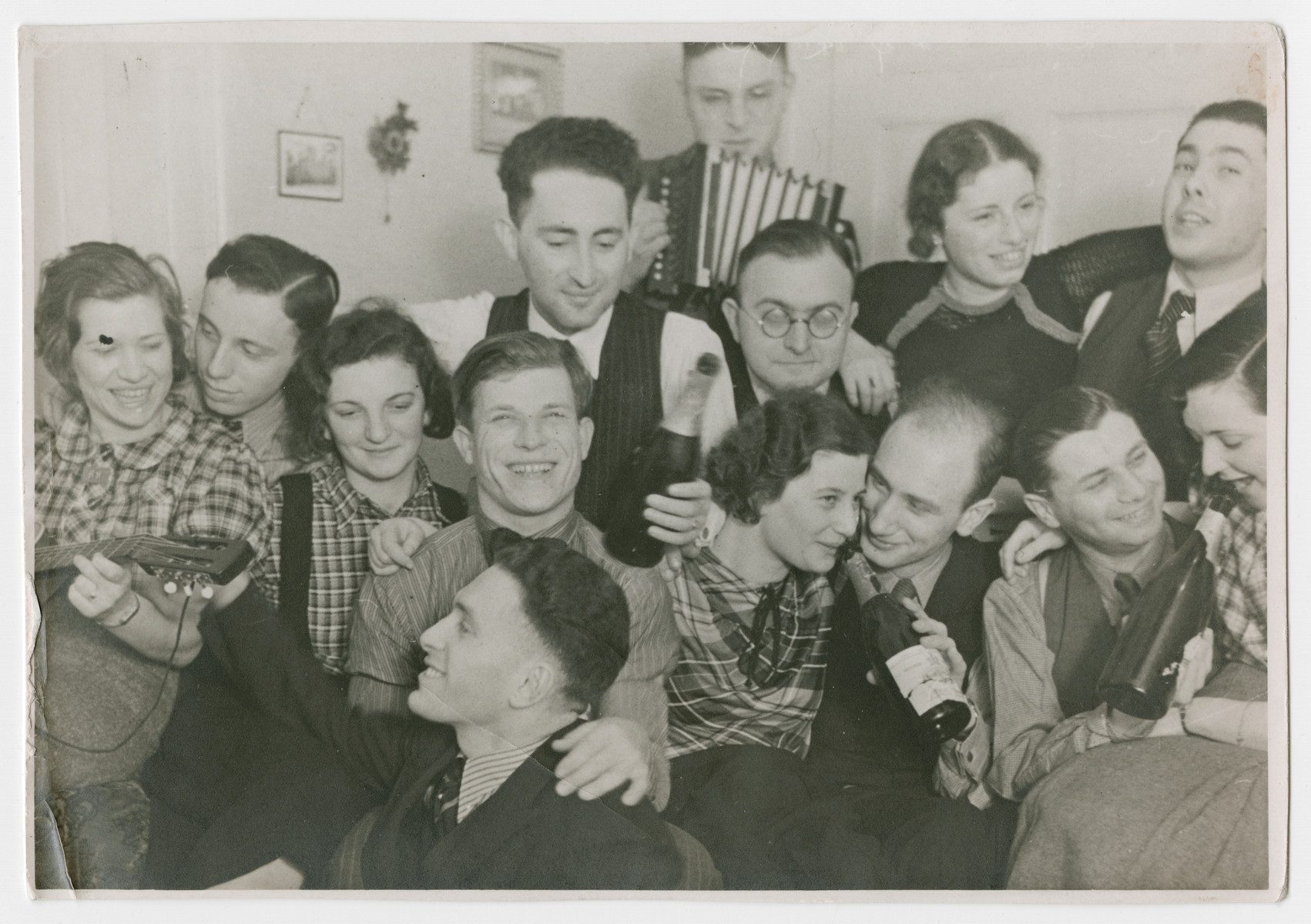 Jewish youth leaders celebrate with an accordion and bottles of champagne at a party in Mannheim.  Eric Sonnenmann is pictured in the center holding a bottle.
