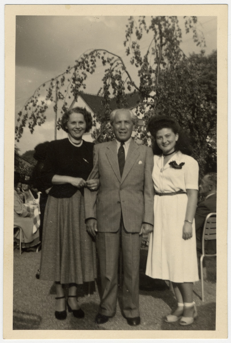 Cesia Honig poses with her aunt and uncle after liberation.  Cesia is pictured on the right.  Her Uncle Max (is in the center.  Max lived with Cesia and her family in Tarnow when he was a young man and was lbecame like an older brother to Cesia.