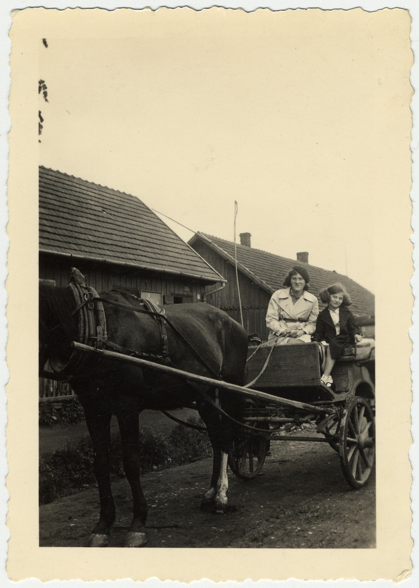 Cesia Honig (right) goes for a ride on a horse and wagon with a woman (possibly her mother).