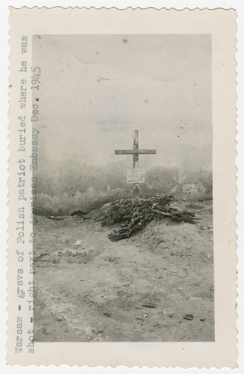 """Grave of a Polish patriot was was shot and buried next to the American Embassy.  The original caption reads: """"The five pictures on this page are very depressing.  I took them to show bodies being exhumed after the war in Warsaw from their burial places which were most anyplace after they were shot and killed."""""""