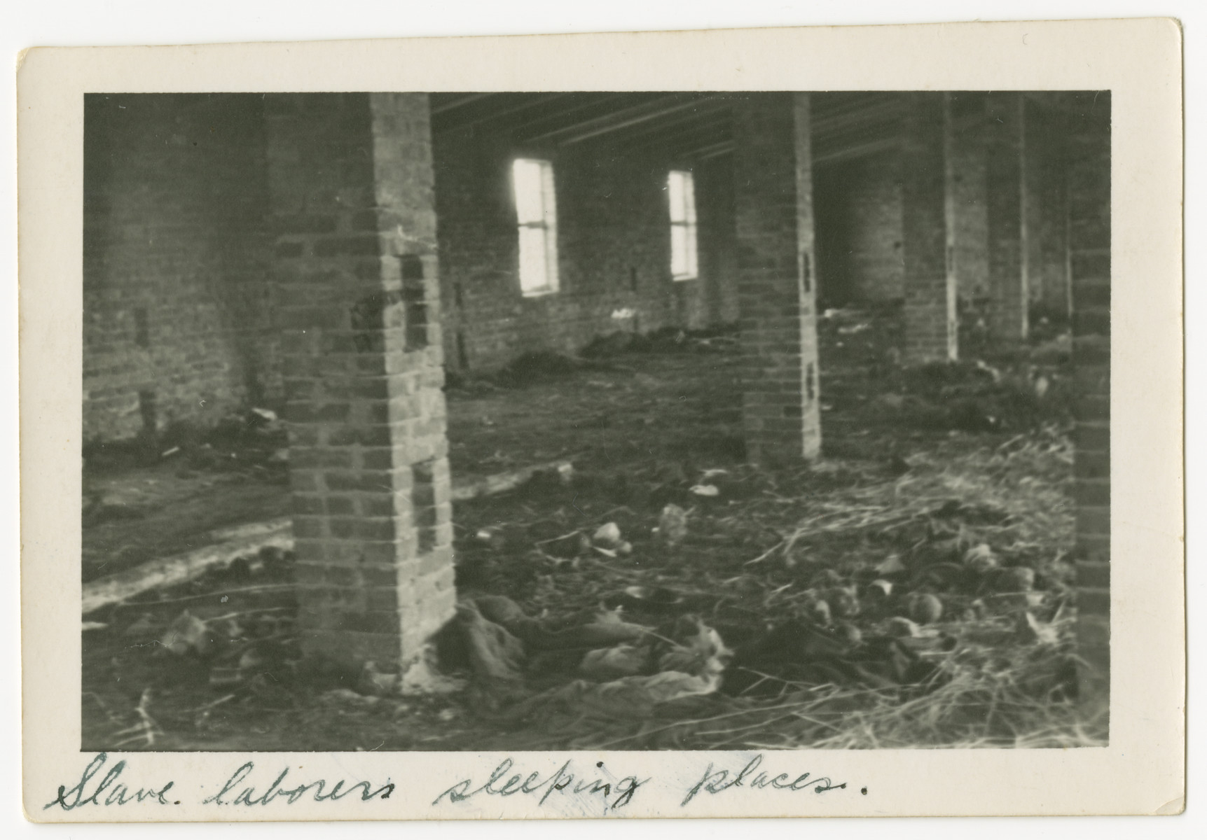 "An interior view of the sleeping quarters for the slave laborers at the Woebbelin concentration camp.  The photograph's original caption reads, ""Slave laborers sleeping places."""