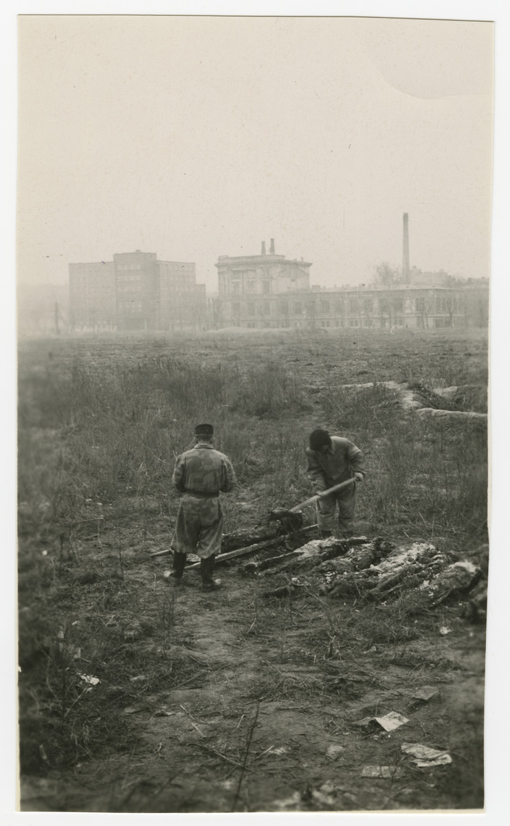 "Polish men exhume corpses in a field in Warsaw.  The original caption reads: ""The five pictures on this page are very depressing.  I took them to show bodies being exhumed after the war in Warsaw from their burial places which were most anyplace after they were shot and killed."""