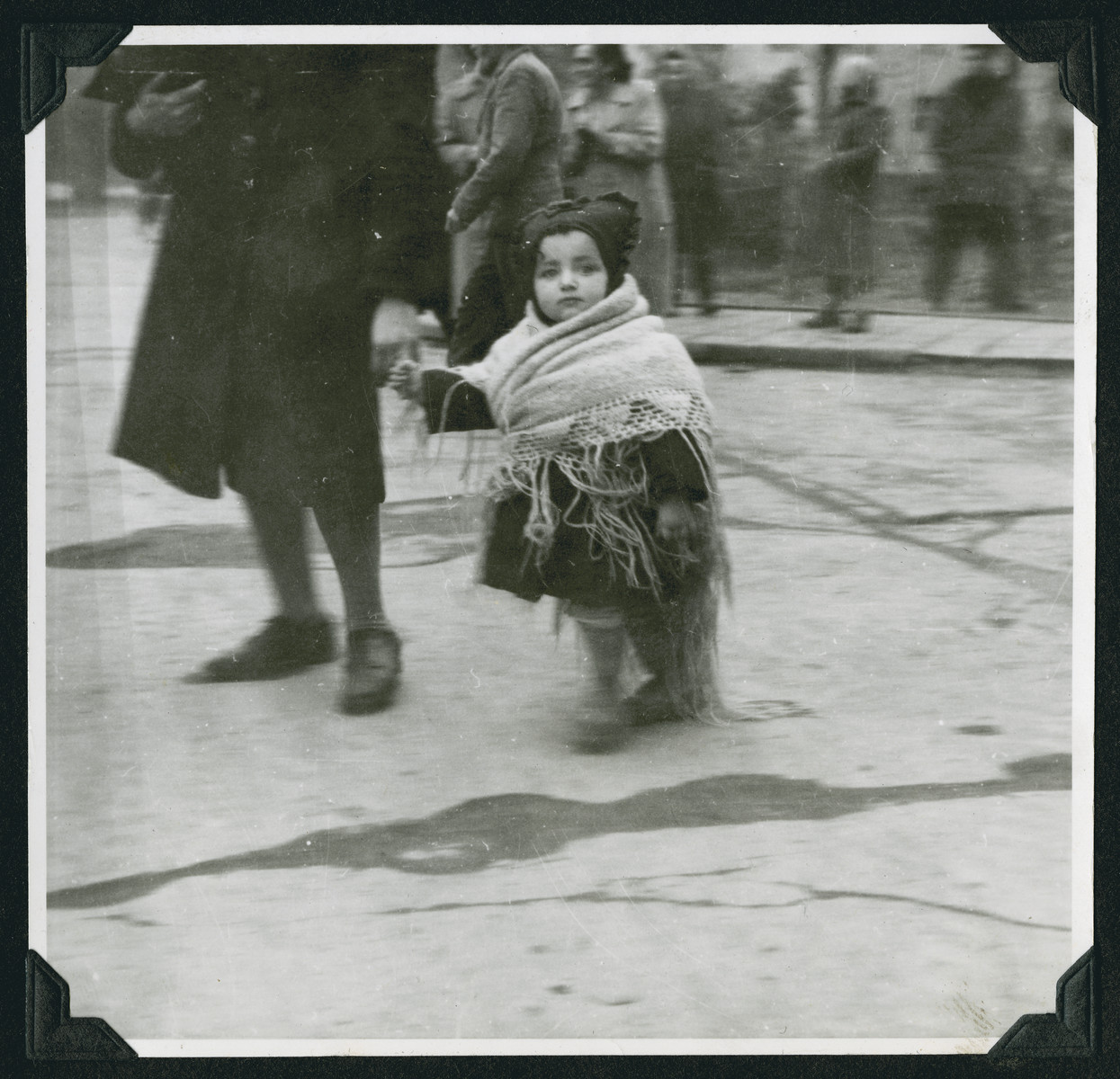 Close-up of a young child wrapped in a shawl in the Wetzlar displaced persons camp.