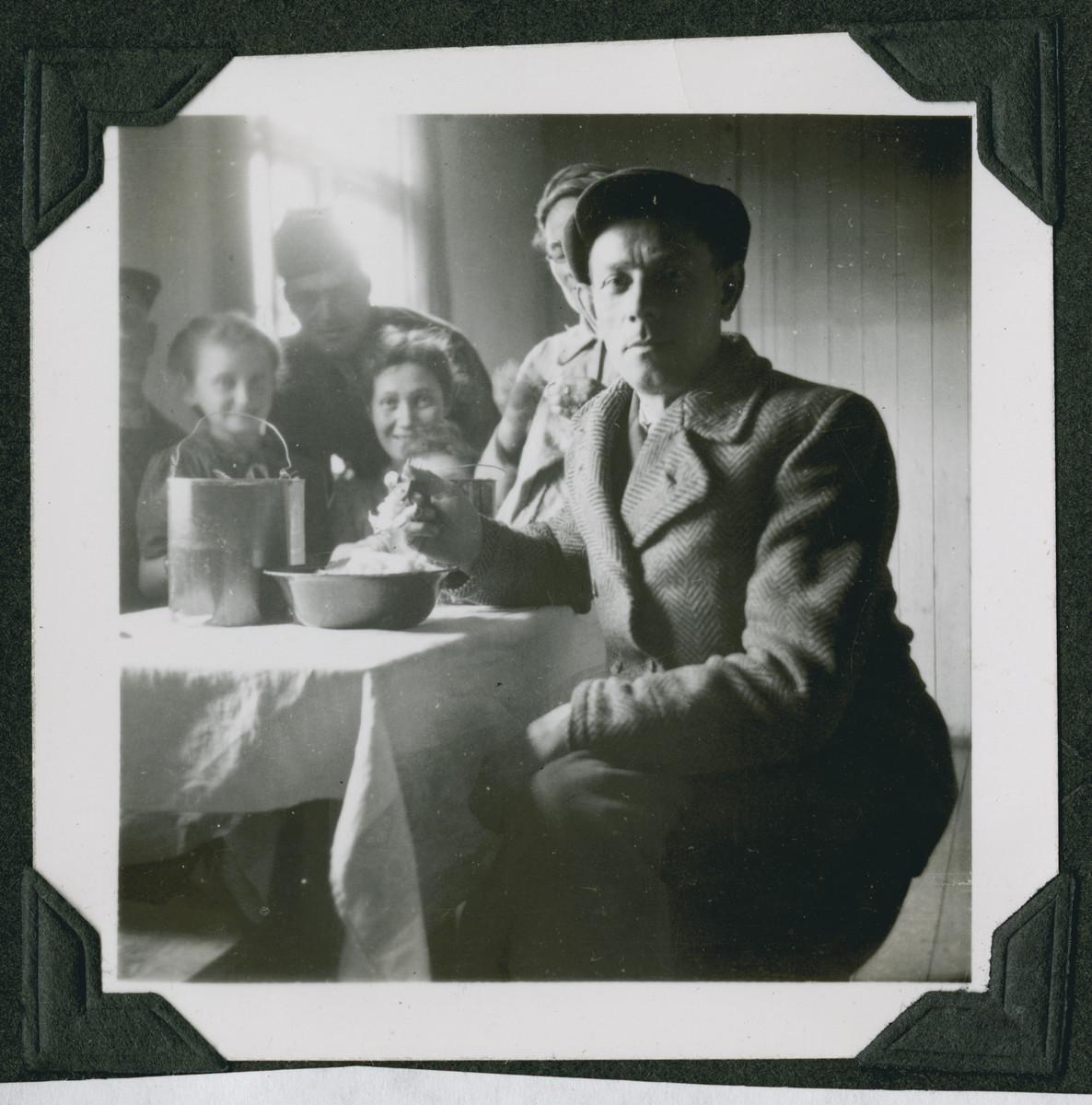 A Jewish family eats its meal in a barrack in the Ziegenhain displaced persons camp.