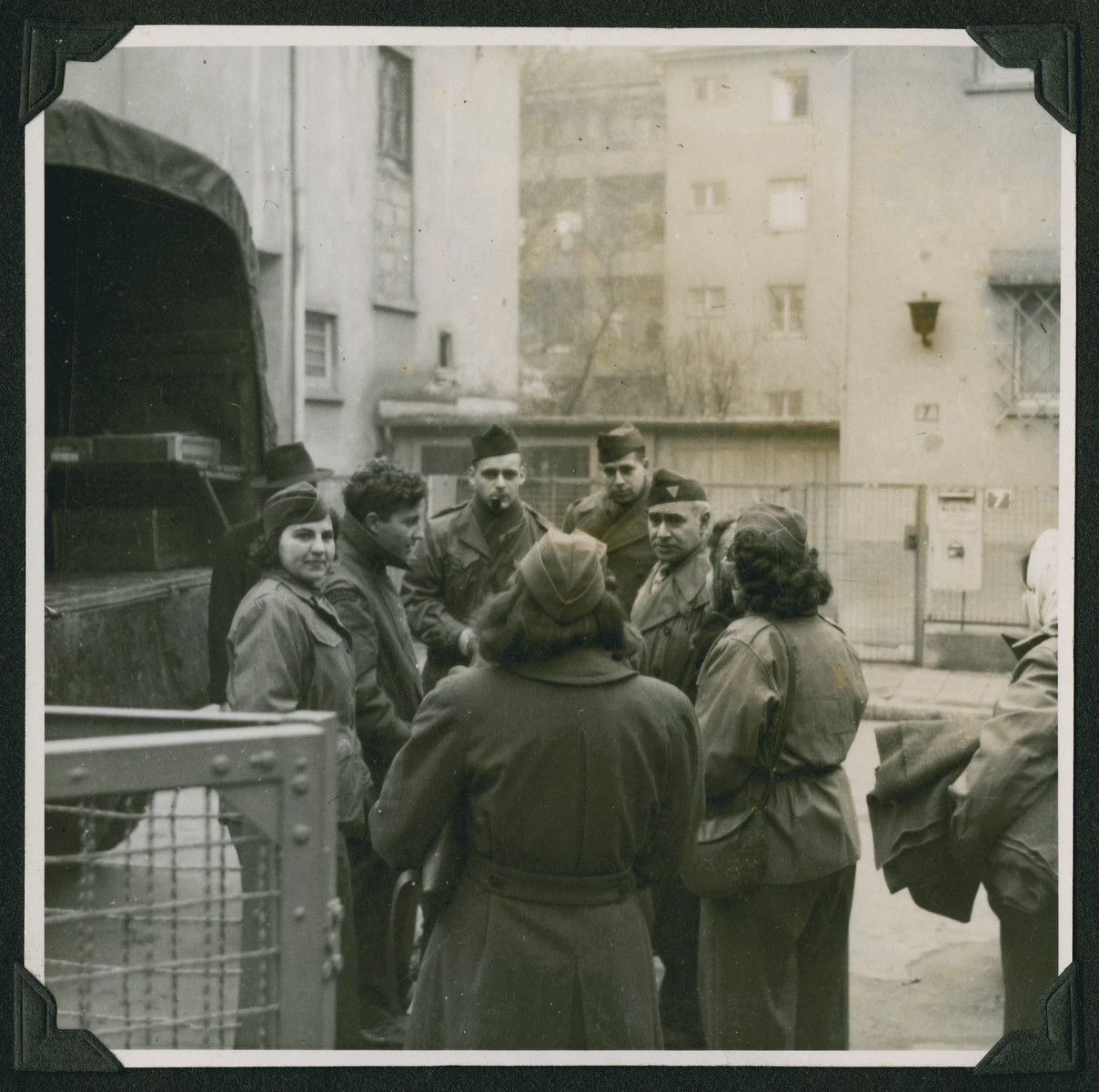 Members of the Frankfurt Jewish GI Council prepare to load supplies onto a truck to take to needy displaced persons in Babenhausen.  Maurice Levitt is standing in the center on the left facing the camera.  Yehuda Lev is second from the left.