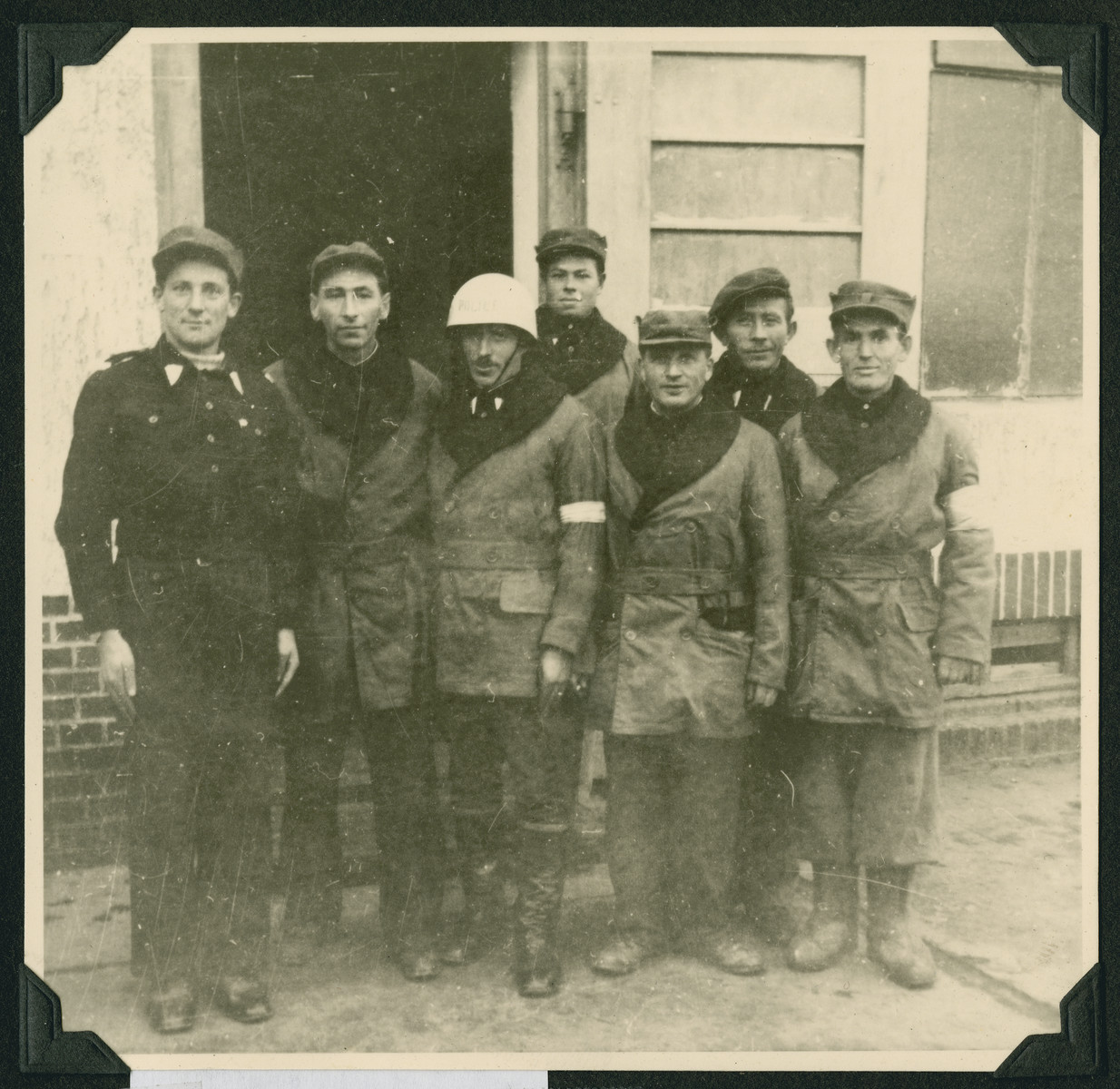 Group portrait of men, including Jewish police, in the Wetzlar displaced persons camp.
