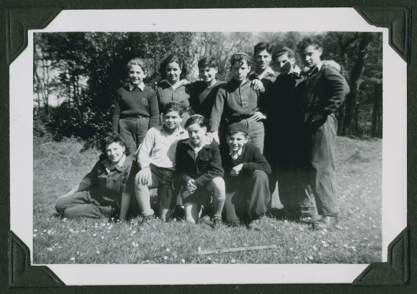 Group portrait of religious Jewish youth in a hachshara in Marquain, Belgium.