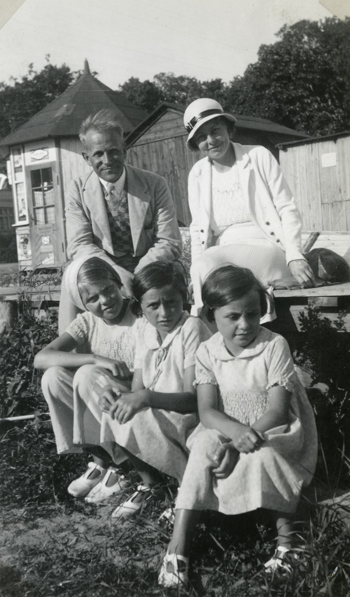 Prewar portrait of a Danish couple, their daughter and her two Jewish friends in prewar Denmark.  Pictured are the Larson family and their daughter Soes and the two Scheirmesiter sisters Inge and Jeanne.