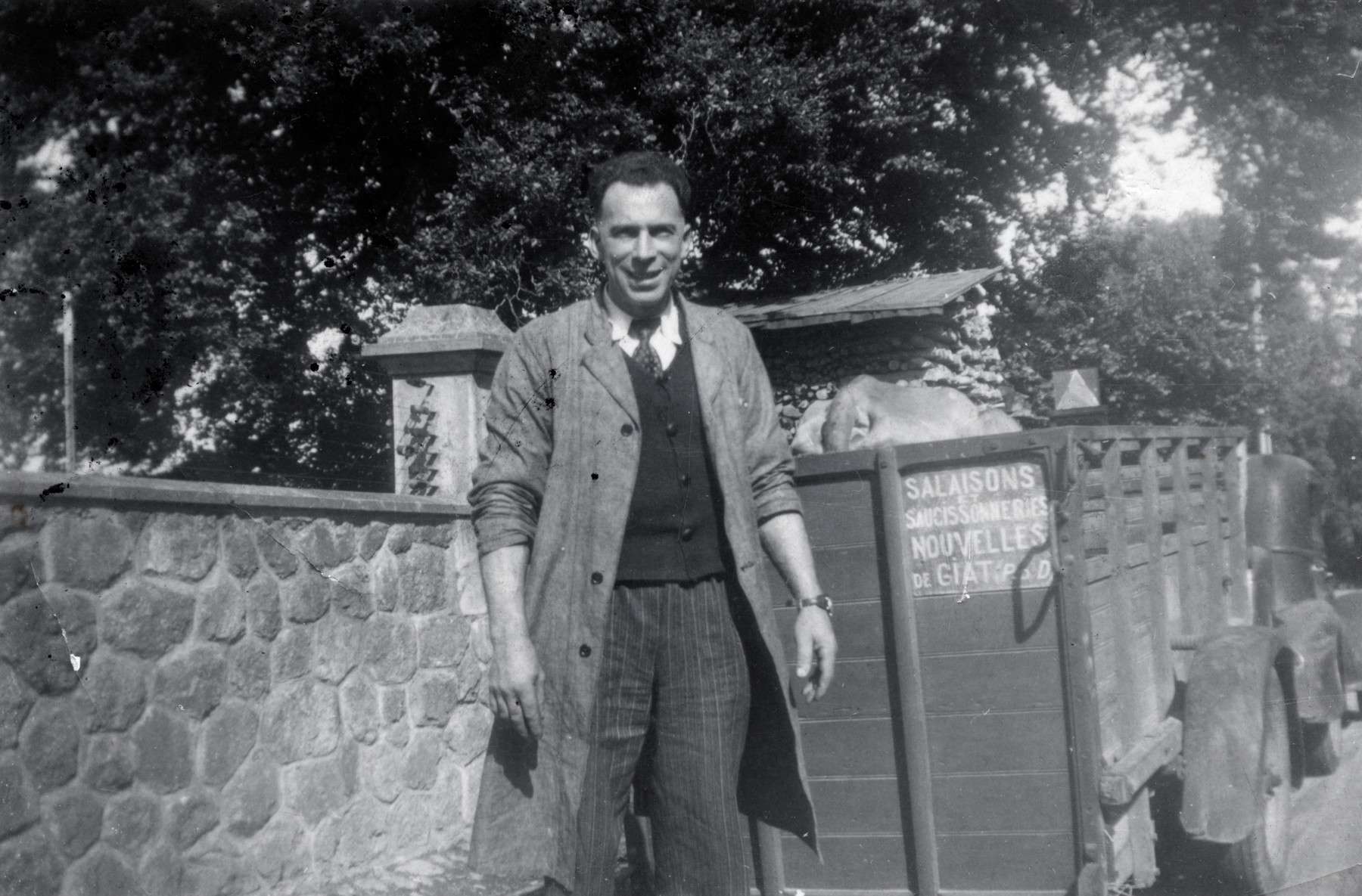 Marcel Michel stands next to the truck for his sausage factory, Salaisons.