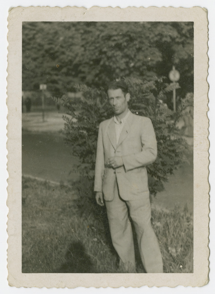 Close-up portrait of a man standing outside [most probably Izrael Beer in the Schlachtensee displaced persons camp].