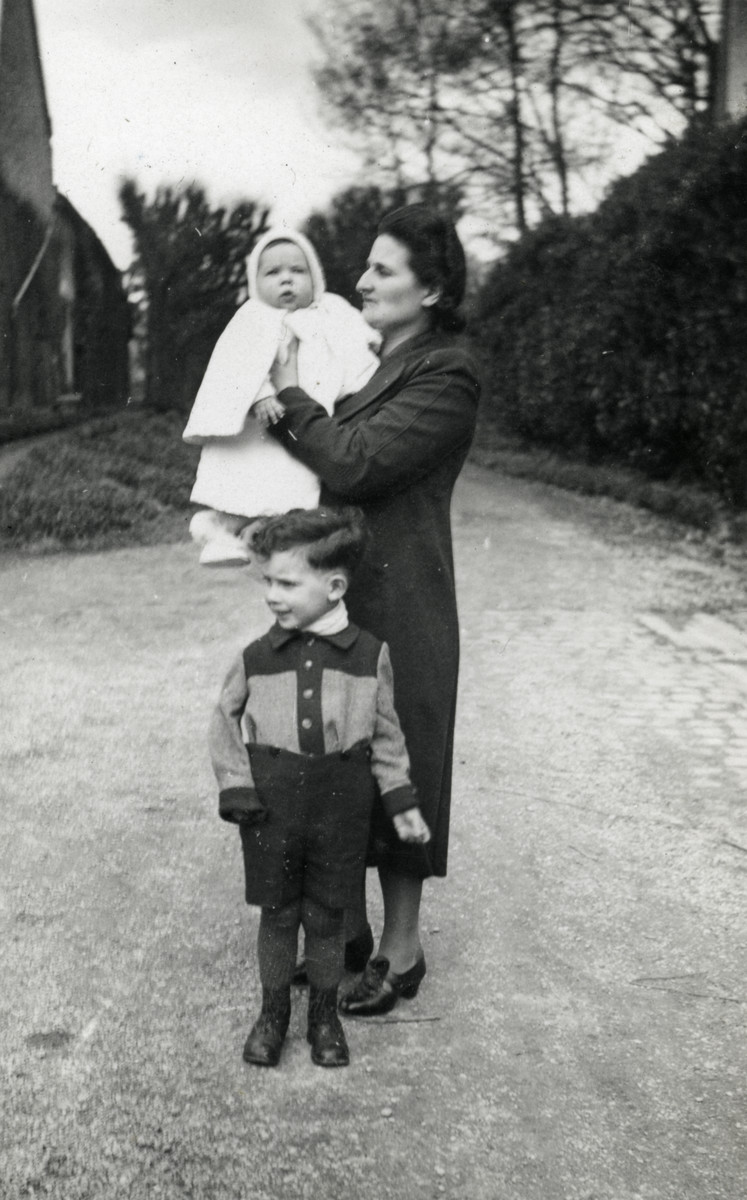 Suzanne Michel, holding her baby Marc, stands with her oldest son Jacques after crossing into Free France.