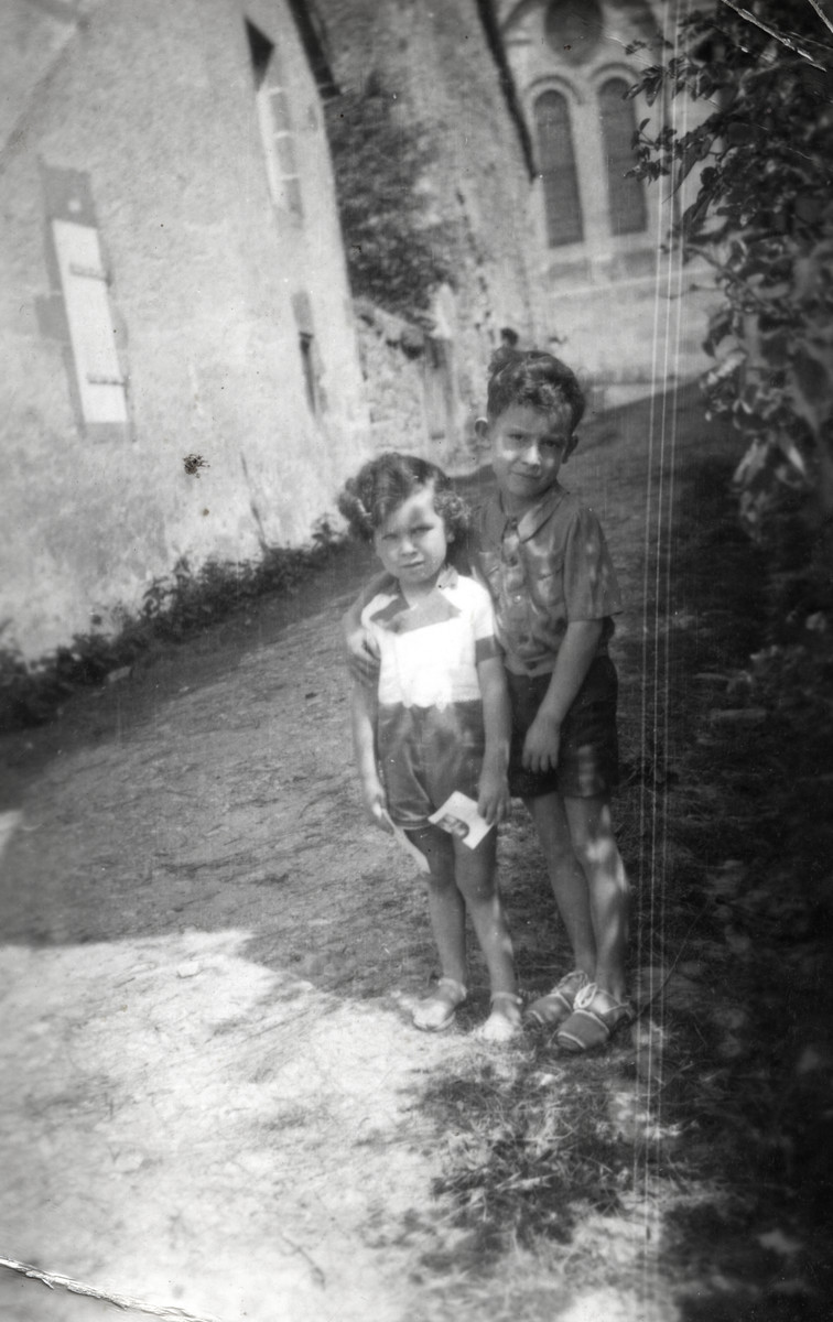 Jacques and Marc Michel stand on a street in Giat.
