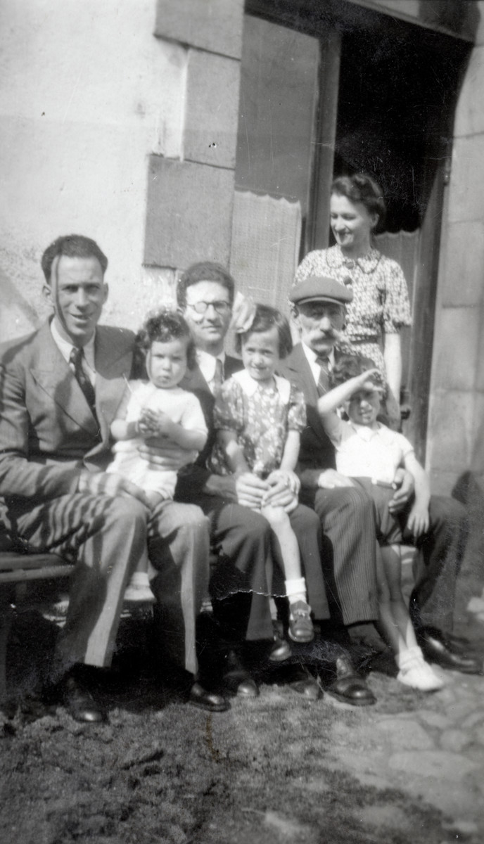 Group portrait of the Michel family in Giat.   Pictured left to right are Marcel Michel, Marc, Uncle Georges, Denise, Grandfather Julian, and Jacques. Aunt Elise (the wife of Georges) is standing.