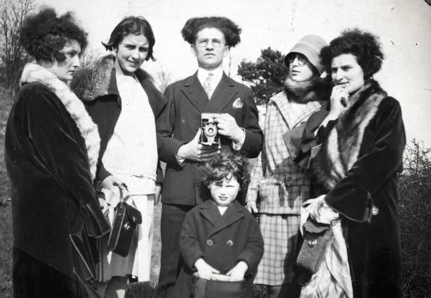 Group portrait of young adults in Alsace.  Suzanne Levy is on the far right, and her sister Germaine Levy is on the far left.